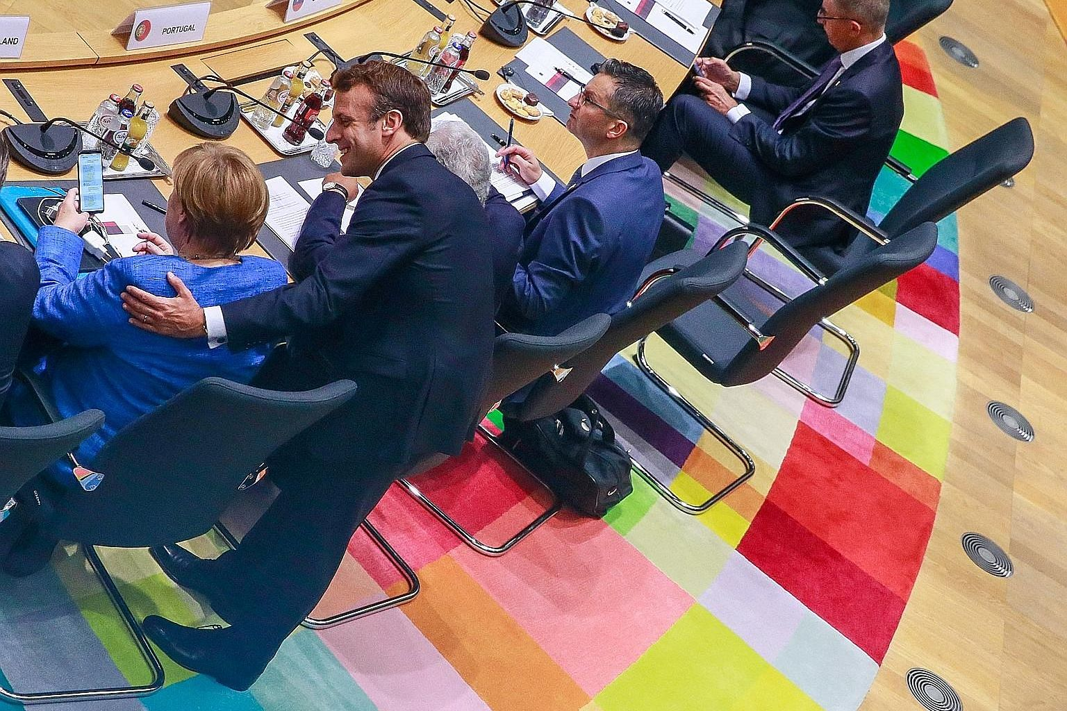 German Chancellor Angela Merkel and French President Emmanuel Macron at yesterday's summit of EU leaders in Brussels. PHOTO: REUTERS
