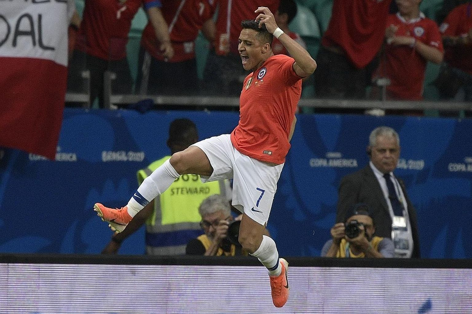 A delighted Alexis Sanchez after scoring for Chile in their 2-1 win over Ecuador during their Copa America match on Friday. PHOTO: AGENCE FRANCE-PRESSE