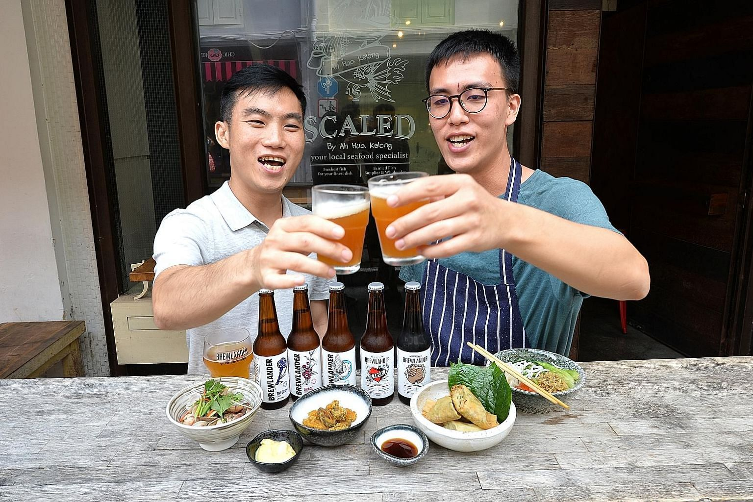 Brewlander master brewer John Wei (left) and Scaled by Ah Hua Kelong chef Kuah Kai Wen with some of the local food-and-beer pairings they are serving up at Beerfest Asia this year.