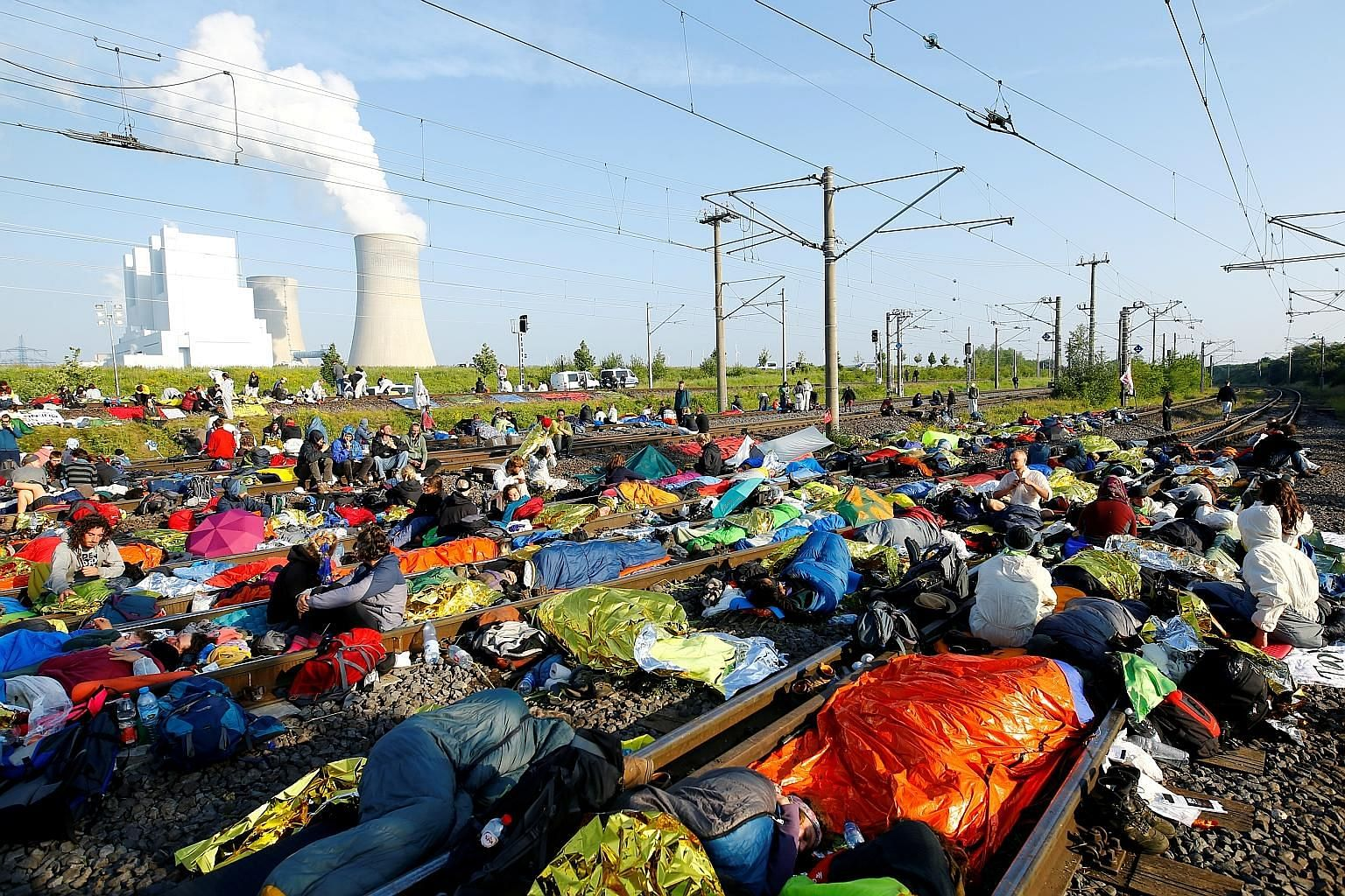 Green activists in Germany blocking railway tracks near a coal mine during a protest for action against climate change yesterday.