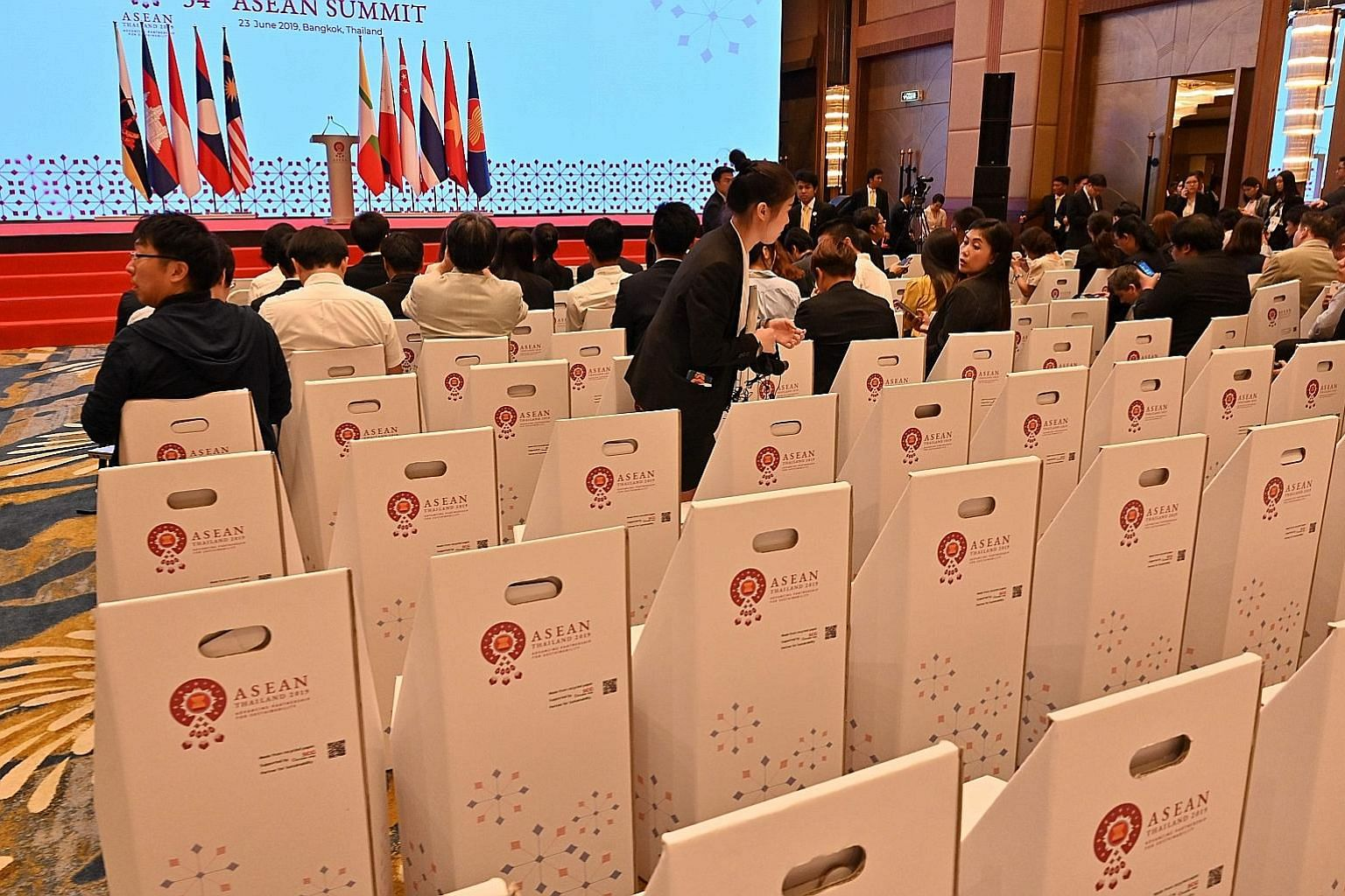 Journalists sitting on chairs made out of paper before a news conference at the 34th Asean Summit yesterday. On Saturday, Asean had committed itself to reducing marine waste at both the national and regional levels. Yesterday, it laid out its Asean O