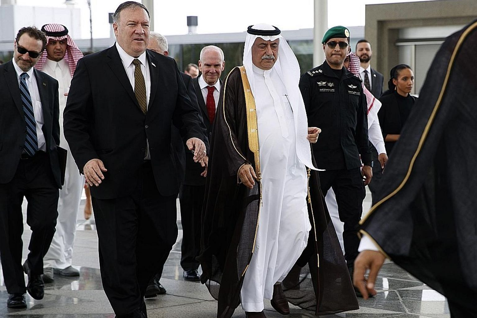 US Secretary of State Mike Pompeo being accompanied by Saudi Foreign Minister Ibrahim Abdulaziz Al-Assaf upon his arrival in Jeddah yesterday. Mr Pompeo was scheduled to hold talks with Saudi Arabia and the United Arab Emirates on the tensions with I
