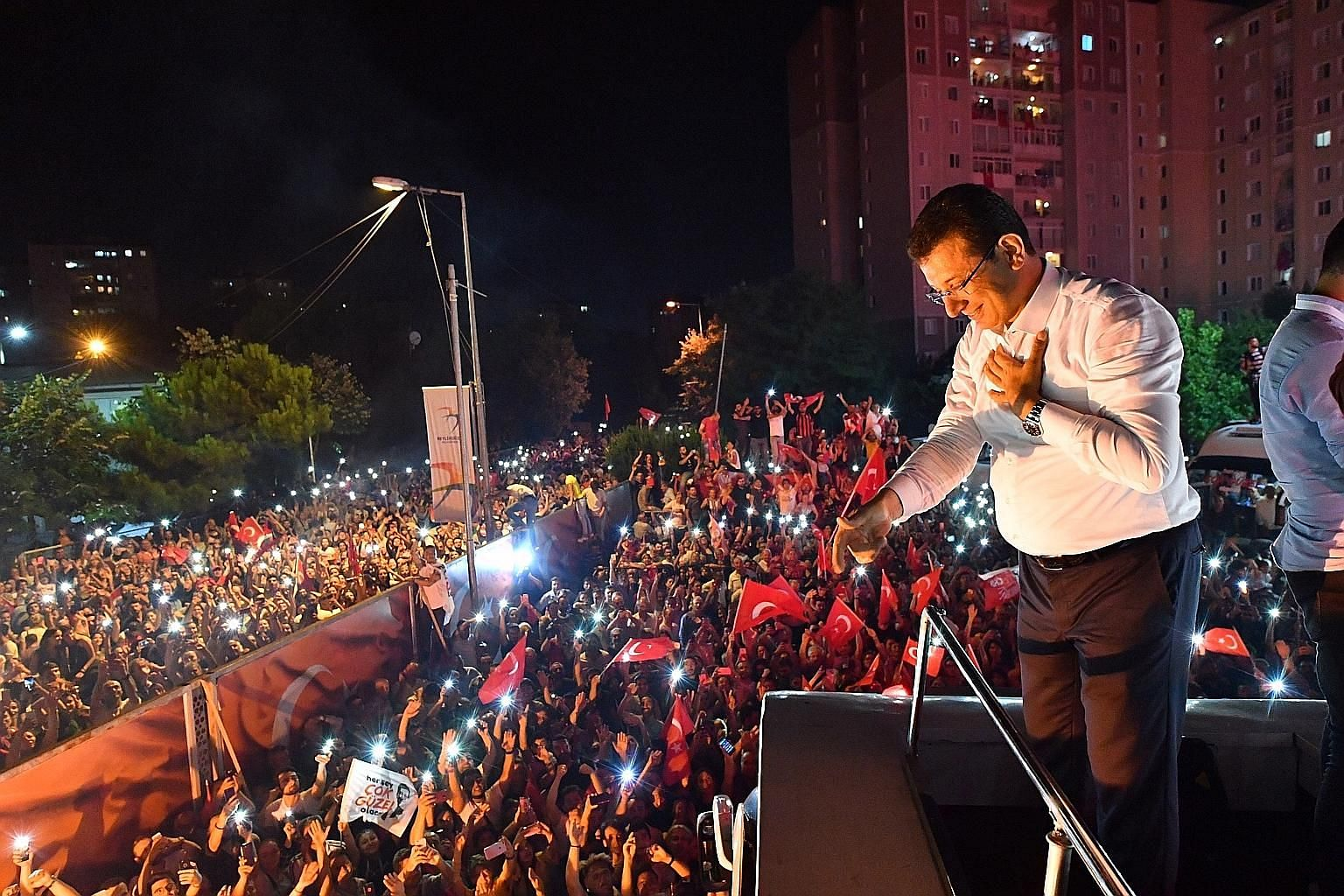 Newly re-elected Istanbul Mayor Ekrem Imamoglu greeting his supporters after his victory on Sunday. The opposition politician gained a decisive 54 per cent of the votes in his victory over the ruling AKP candidate Binali Yildirim's 45 per cent. The l