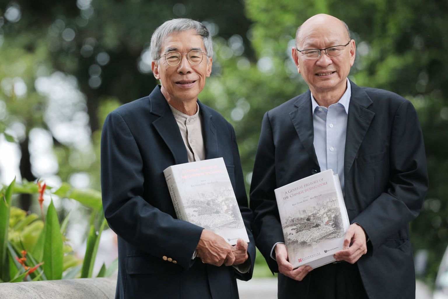Historians Kwa Chong Guan (left) and Kua Bak Lim with copies of the newly launched English edition of A General History Of The Chinese in Singapore, of which they are co-editors.
