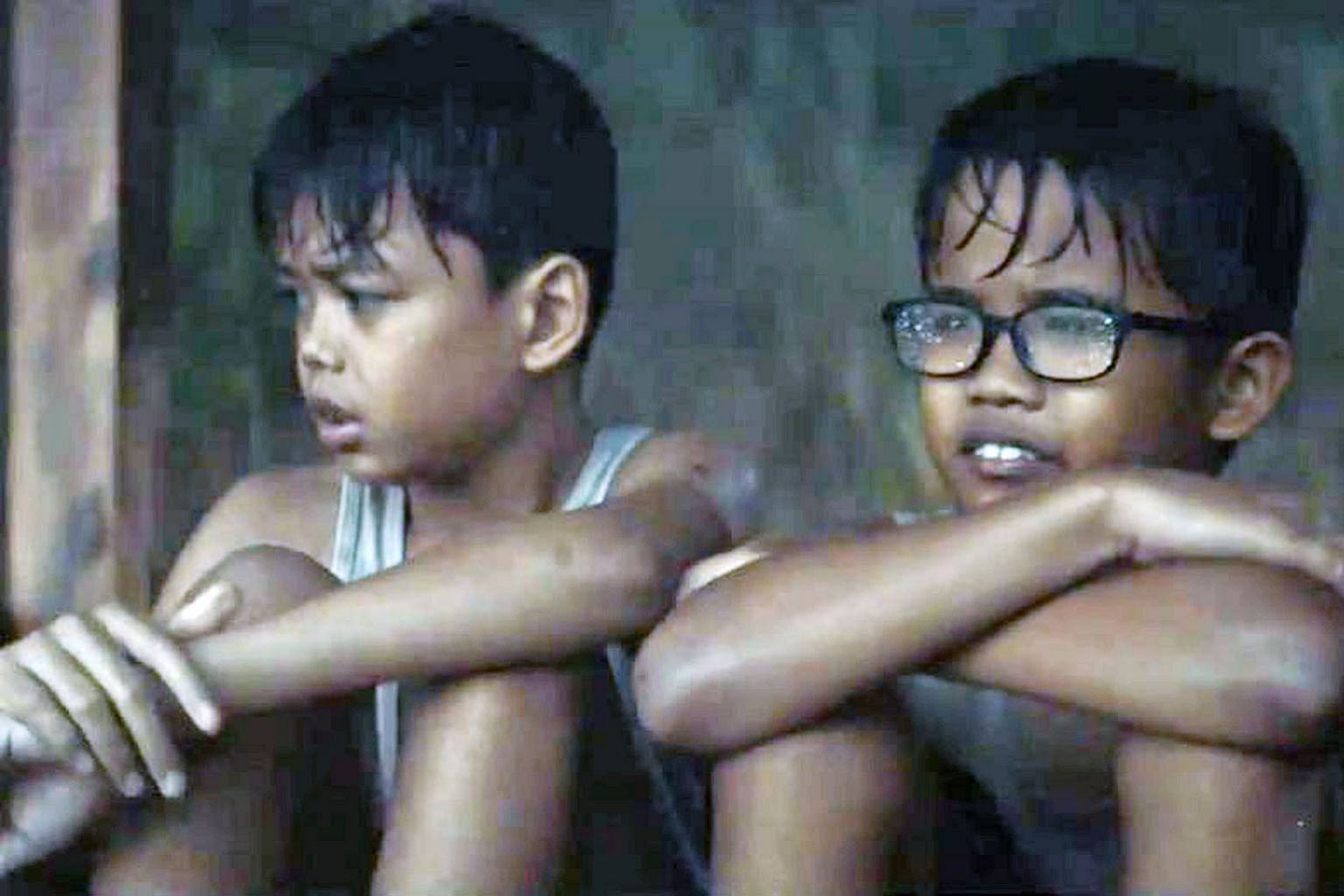 PUB's Hari Raya short film, Kinship, which tells the story of two orphaned brothers, Din (far left) and Zul, is part of its year-long water conservation campaign to drive home the point that everyone has a part to play in using water wisely. PHOTO: P