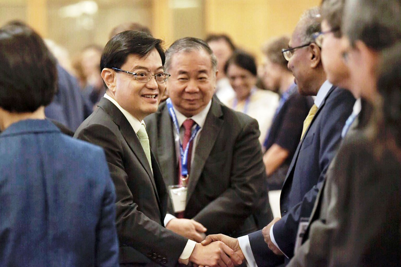 Deputy Prime Minister Heng Swee Keat meeting delegates at the 10th International Conference on Materials for Advanced Technologies at Marina Bay Sands yesterday. He said that as a result of Singapore investing in science and technology R&D since almo