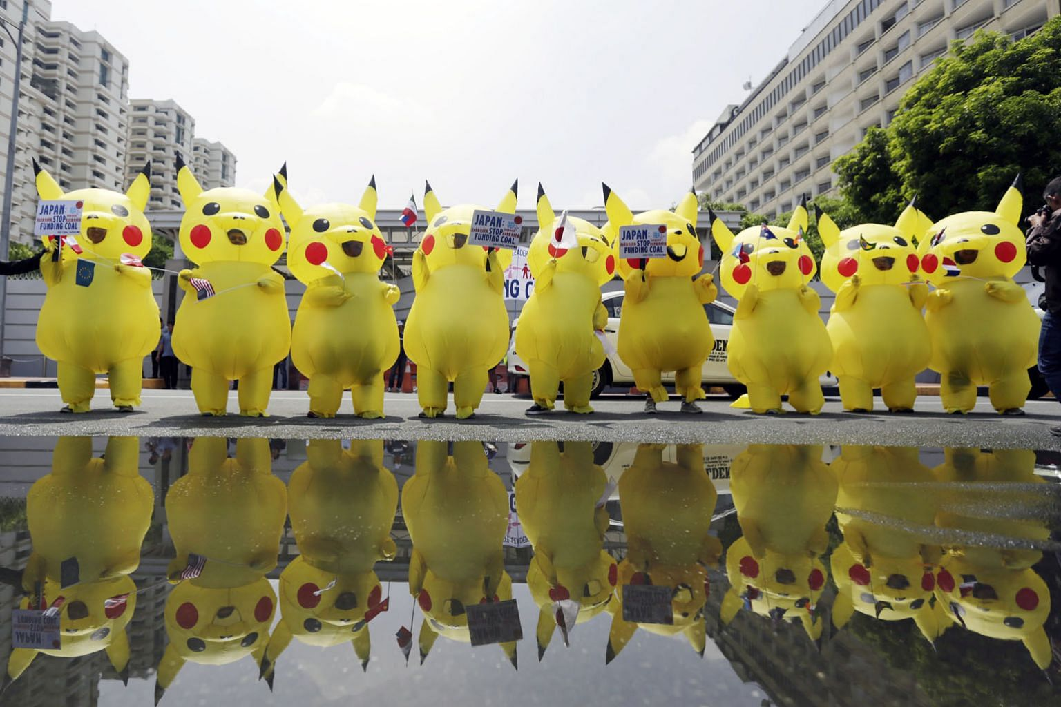 Climate activists in the Philippines from 350.org staging a demonstration dressed in Pikachu costumes in front of the Japanese embassy in Manila yesterday. 350.org was founded in 2008 by a group of university friends in the United States along with a