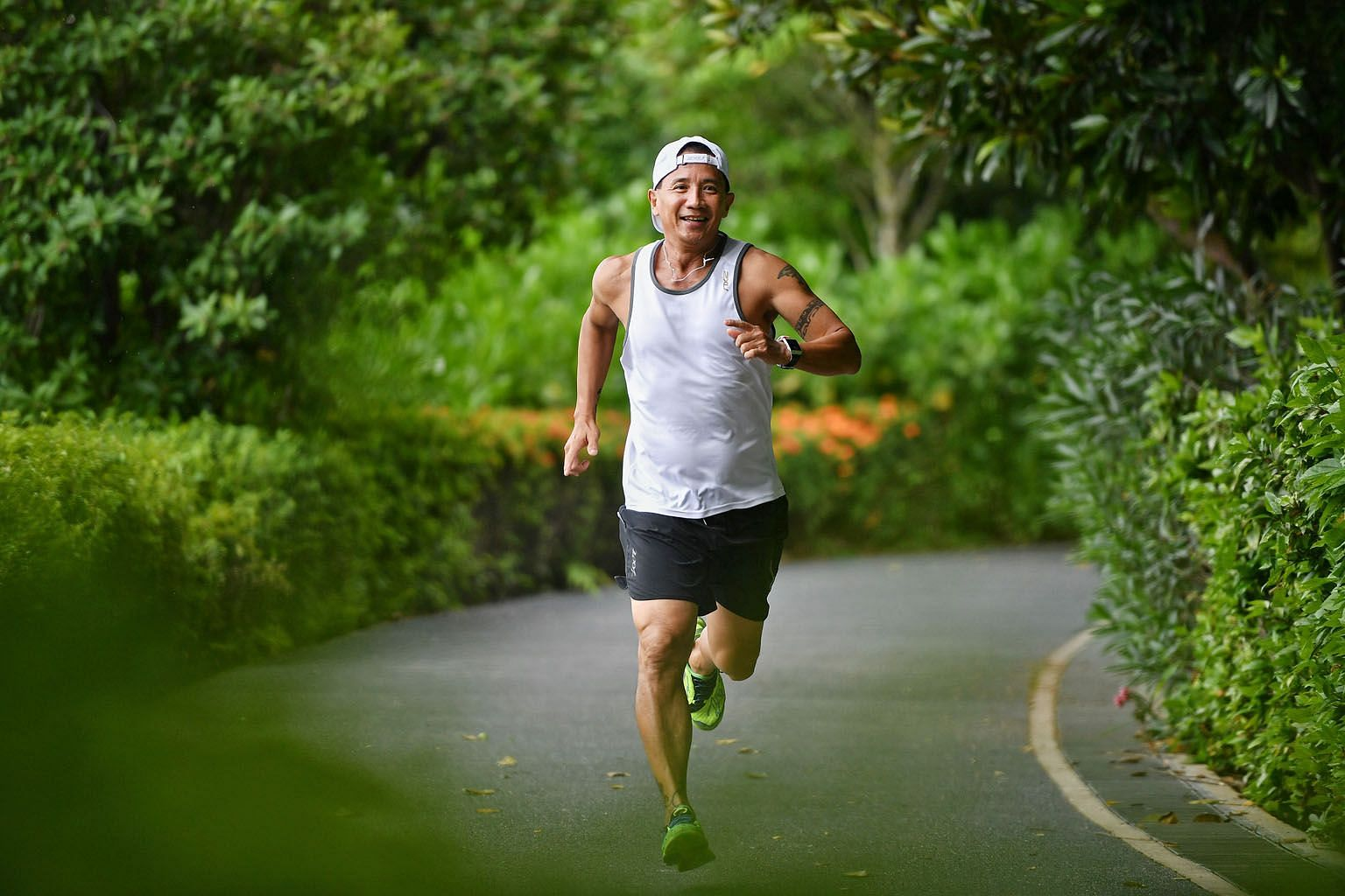 Raymond Howe remains an avid runner while battling the effects of cancer, often participating in marathons and triathlons. He will be taking part in this year's The Straits Times Run, like he has done since the inaugural edition in 2013. ST PHOTO: CH