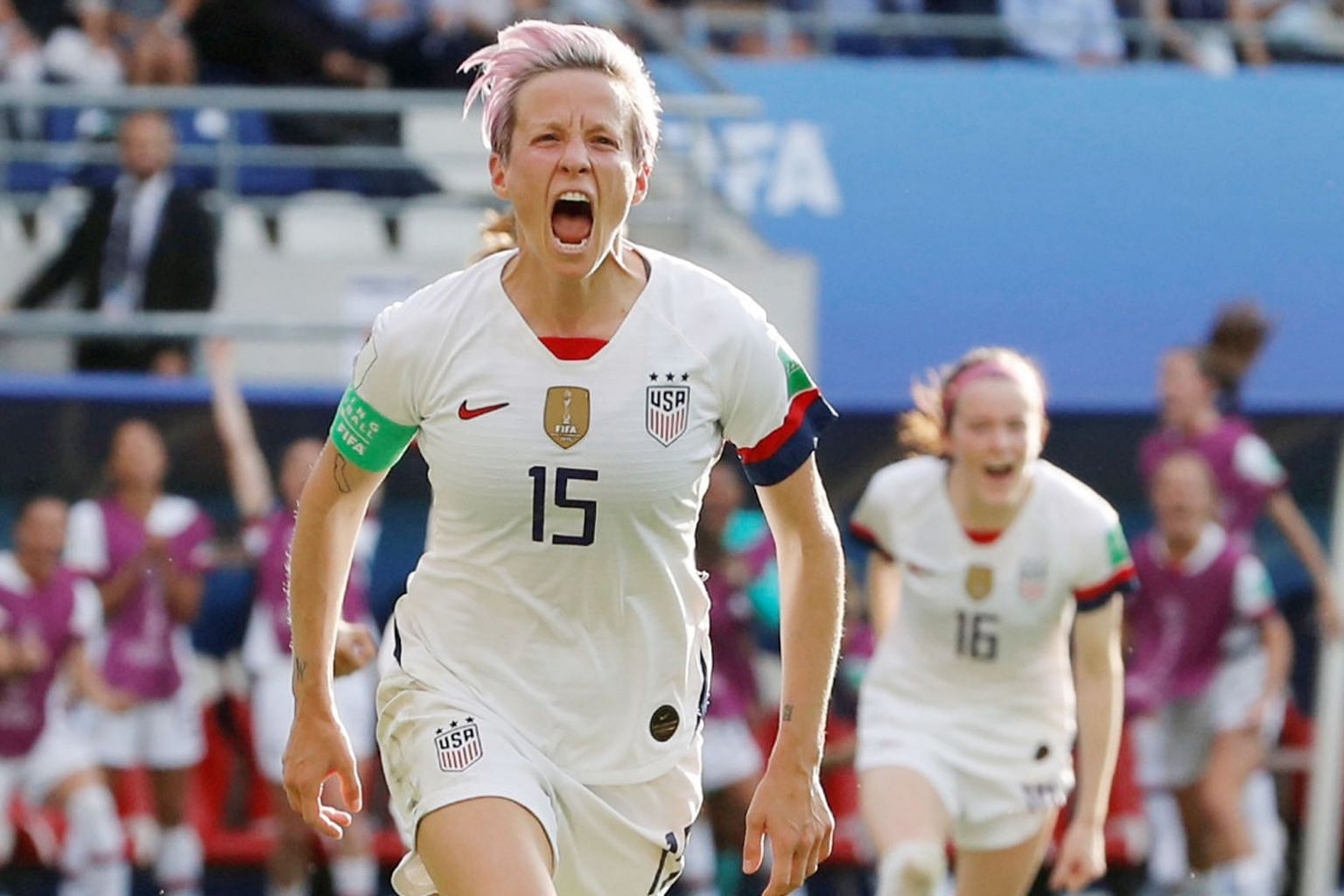 US captain Megan Rapinoe celebrates her second goal from the spot to down Spain 2-1. The defending champions will next face hosts France in the last eight. PHOTO: REUTERS