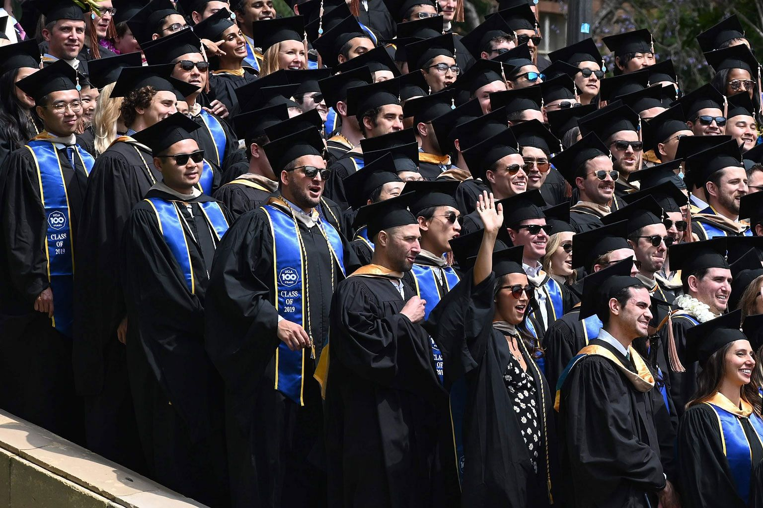 Graduating students posing for a class picture at the University of California Los Angeles on June 14. Some 360,000 Chinese students study in the US. The assertion that the Communist Party is somehow exerting control over this number from afar denies