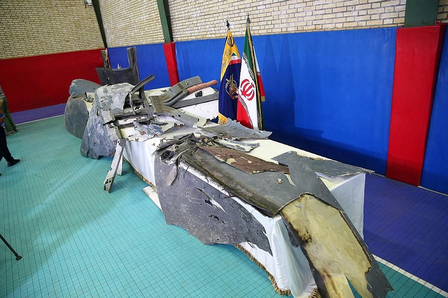 The purported wreckage of the American drone on display by the Islamic Revolutionary Guard Corps in Teheran last Friday. Iran said it was found 6.4km within its territorial waters.