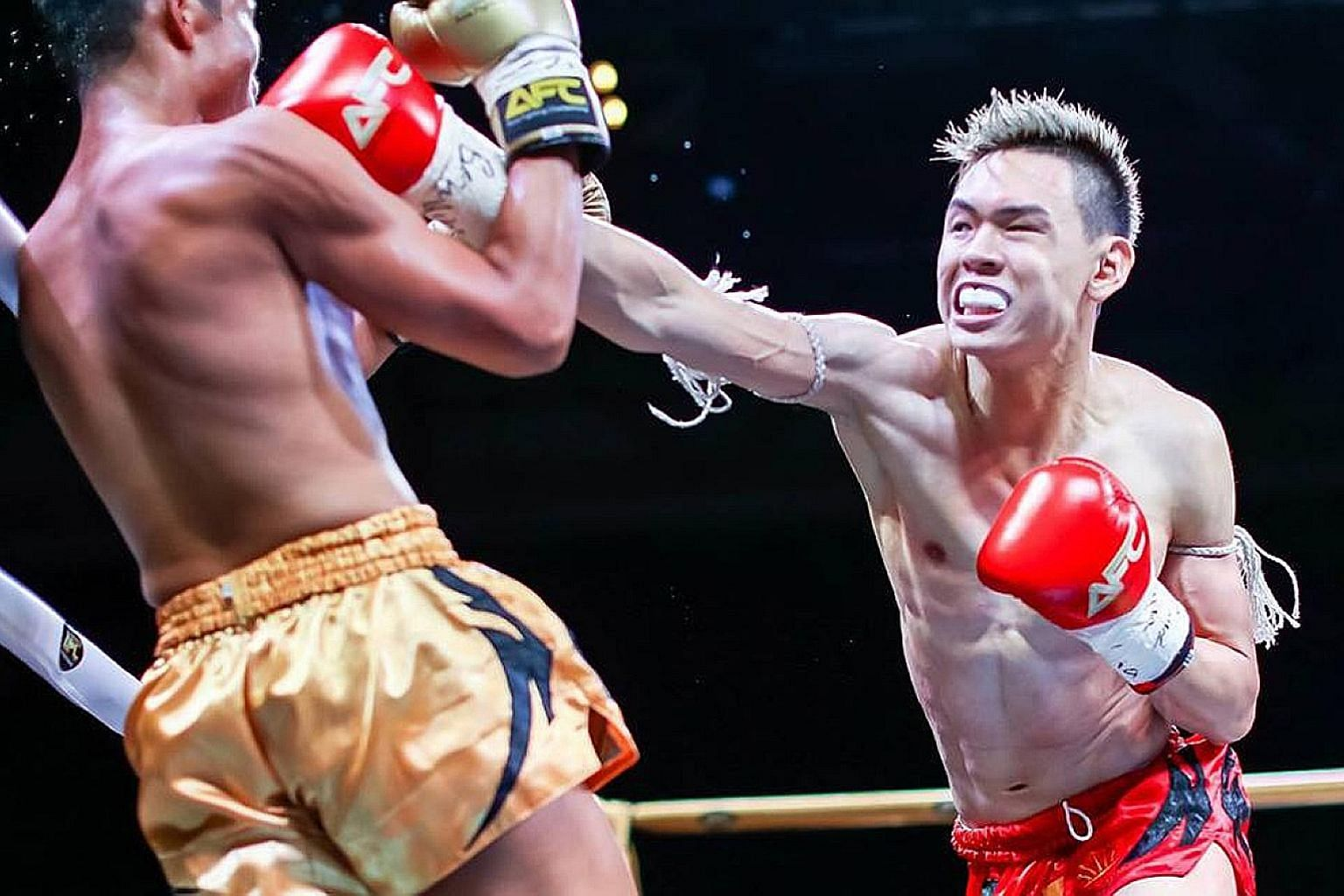 Wynn Neo (in red), seen here competing at the Asia Fighting Championship in 2017, will compete for the WBC muay thai featherweight title at SFC 7 on Saturday. PHOTO: FACEBOOK/ASIA FIGHTING CHAMPIONSHIP