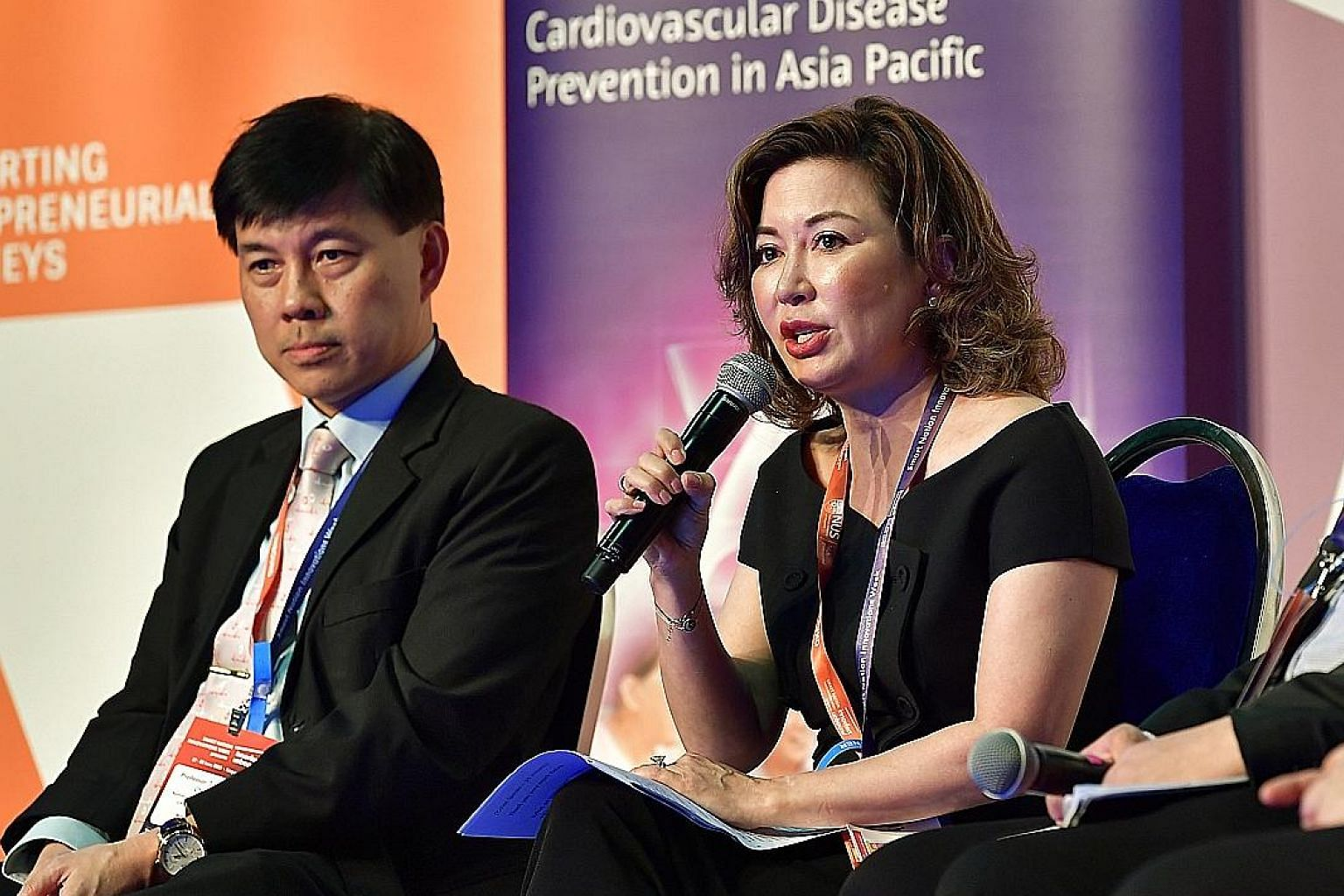 Associate Professor Angelique Chan, executive director of the Centre for Ageing, Research and Education at Duke-NUS Medical School, speaking at the Healthy Hearts, Healthy Ageing Asia Pacific Report launch. With her is National University Heart Centr