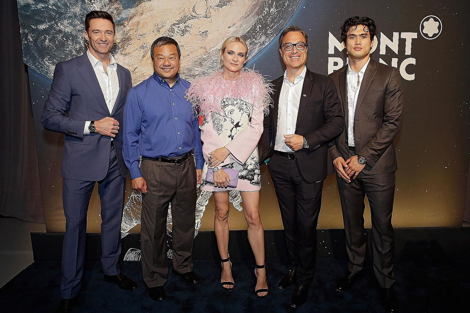 At the launch of Montblanc's re-imagined line of StarWalker pens are (from left) actor Hugh Jackman, former astronaut Leroy Chiao, actress Diane Kruger, Montblanc's chief executive officer Nicolas Baretzki and actor Charles Melton.