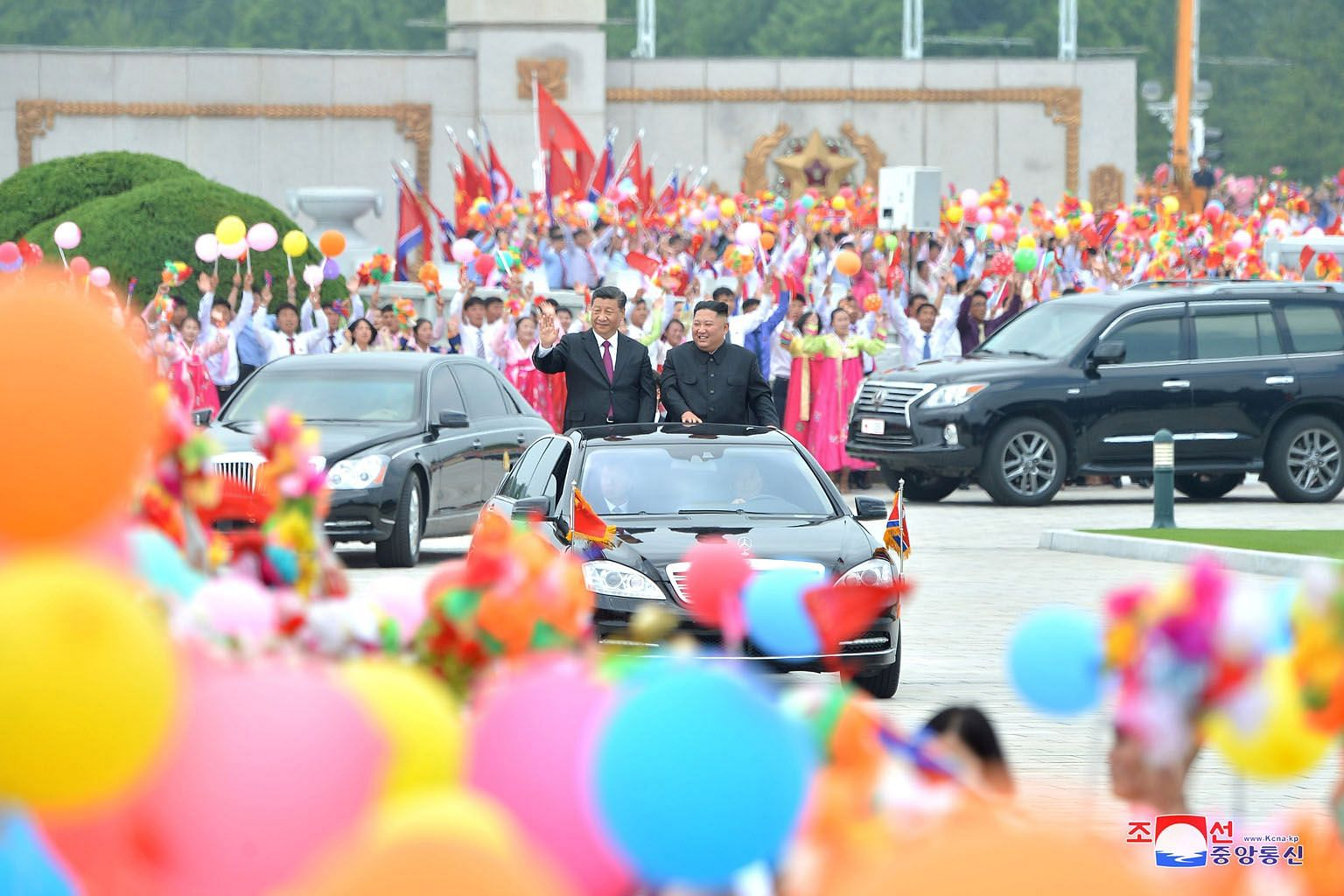 North Korean leader Kim Jong Un with Chinese President Xi Jinping at a welcome ceremony at the Pyongyang International Airport during Mr Xi's visit last week. The writer states that in the longer term, better ties work for both Beijing's and Pyongyan