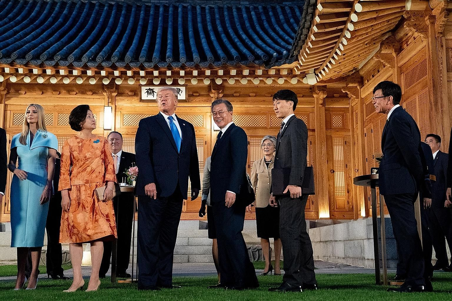 United States President Donald Trump and South Korean President Moon Jae-in at the presidential Blue House yesterday. With them are (from left) Mr Trump's daughter Ivanka, South Korean First Lady Kim Jung-sook and US Secretary of State Mike Pompeo.