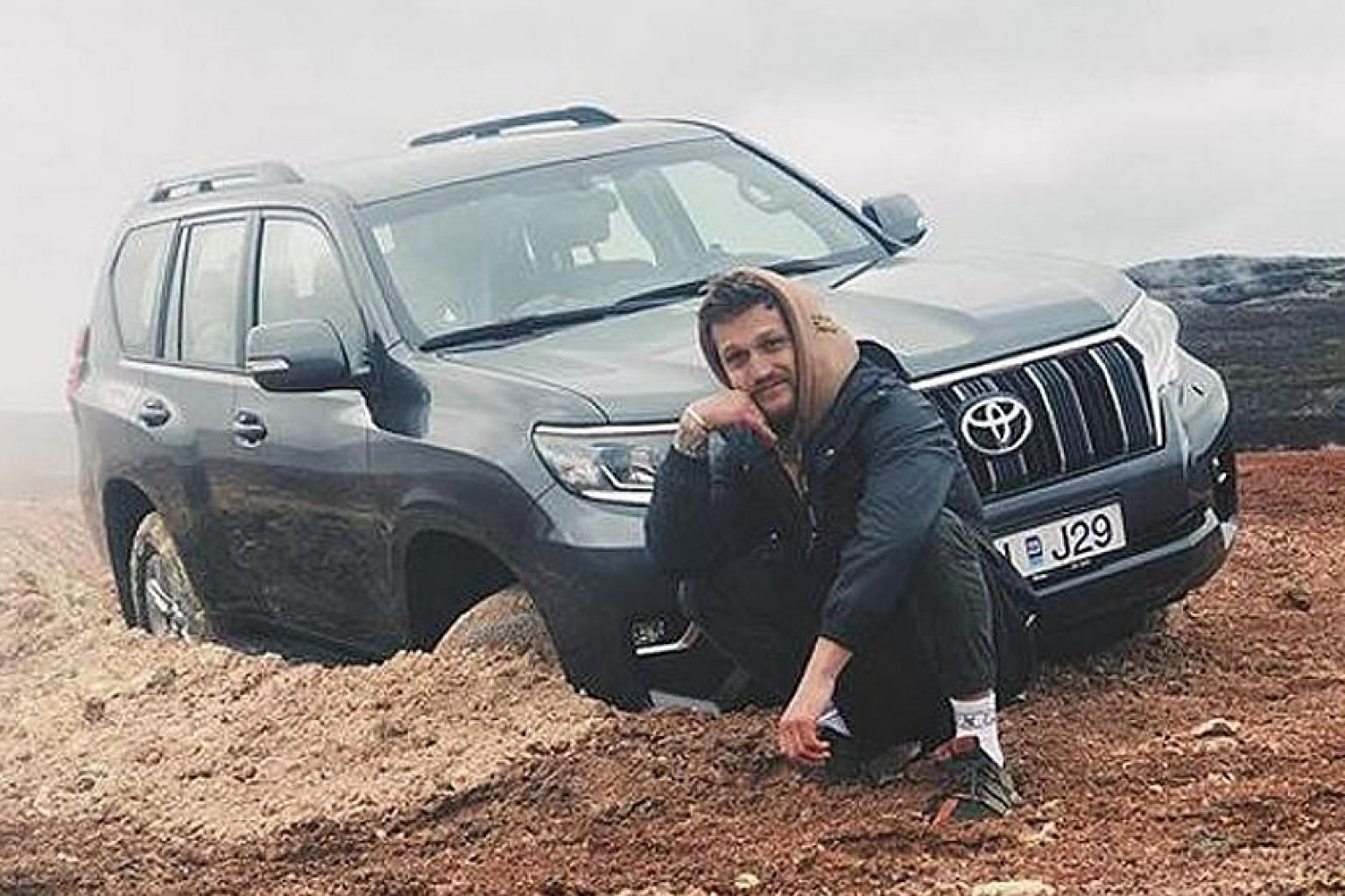 Mr Alexander Tikhomirov, an Instagram influencer from Russia, received a flood of negative comments after he posted this photo of himself with the vehicle he was in, stuck in soft clay on the side of the road in Iceland. Off-road driving is illegal t