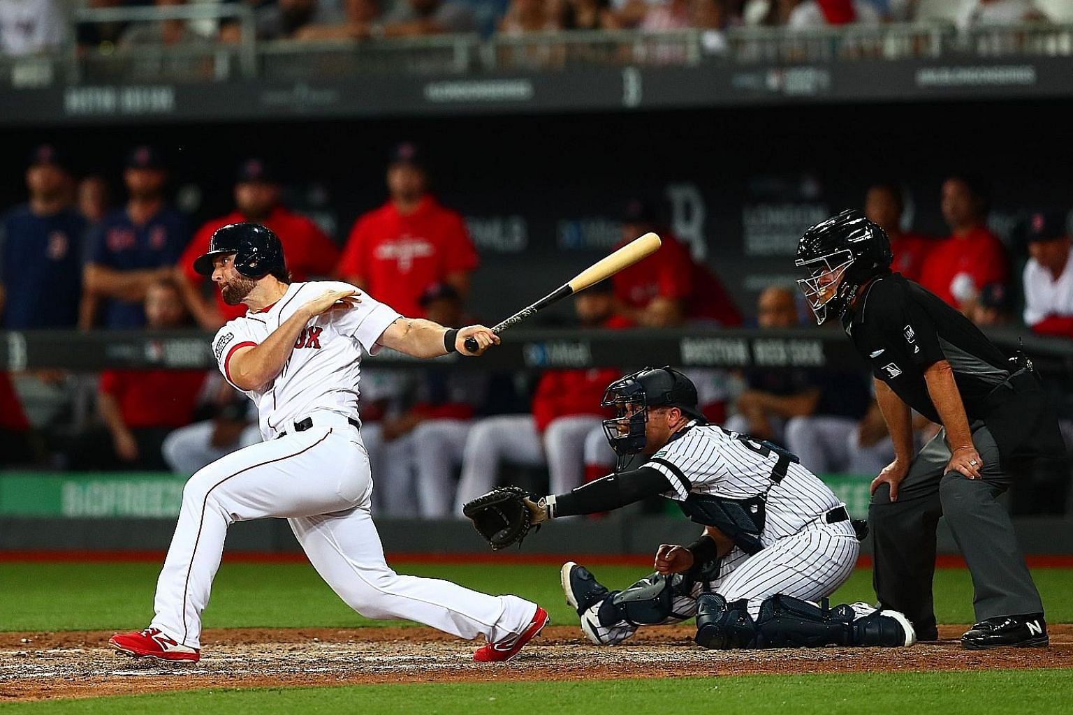 Sam Travis of the Boston Red Sox watching the last hit of the game fly towards second base during Game 1 of the Major League Baseball London Series on Saturday, as Boston and the New York Yankees took their legendary rivalry to Europe for the first t