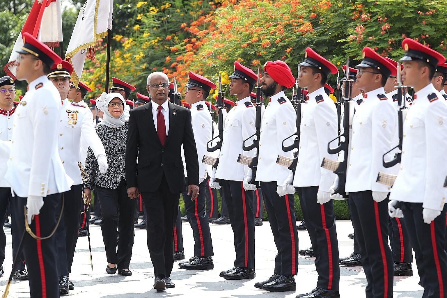 Maldivian President Ibrahim Mohamed Solih inspecting the guard-of-honour with President Halimah Yacob during the welcome ceremony at the Istana yesterday. Mr Solih, who is on his first state visit to Singapore, was accompanied by his wife, First Lady