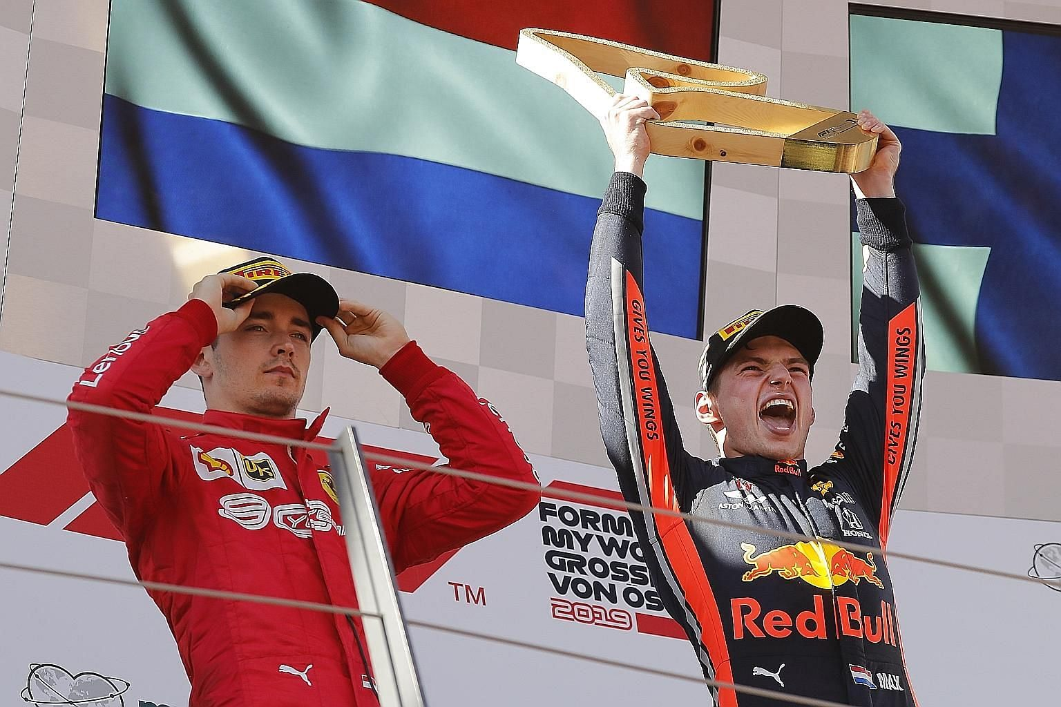 Red Bull's Max Verstappen celebrating with the Austrian Grand Prix trophy, his sixth F1 win, after coming from behind to deny Charles Leclerc of Ferrari his first victory on Sunday. PHOTO: EPA-EFE