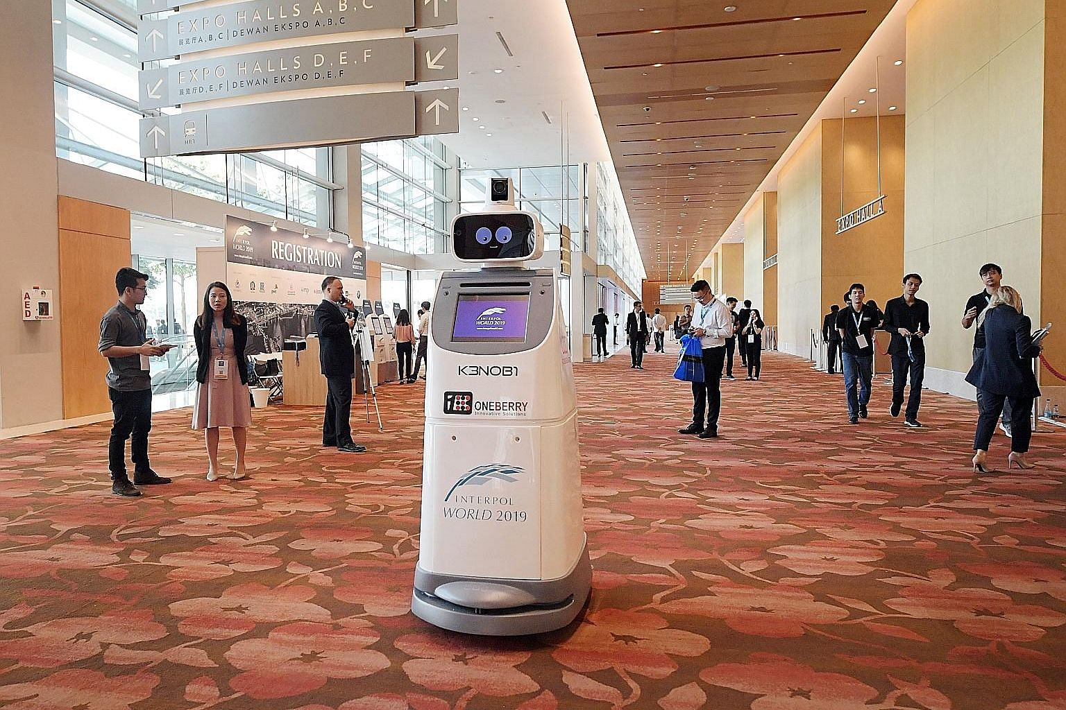 Robot security guard KenOBI deployed by OneBerry Technologies at the Interpol World conference at Marina Bay Sands yesterday.