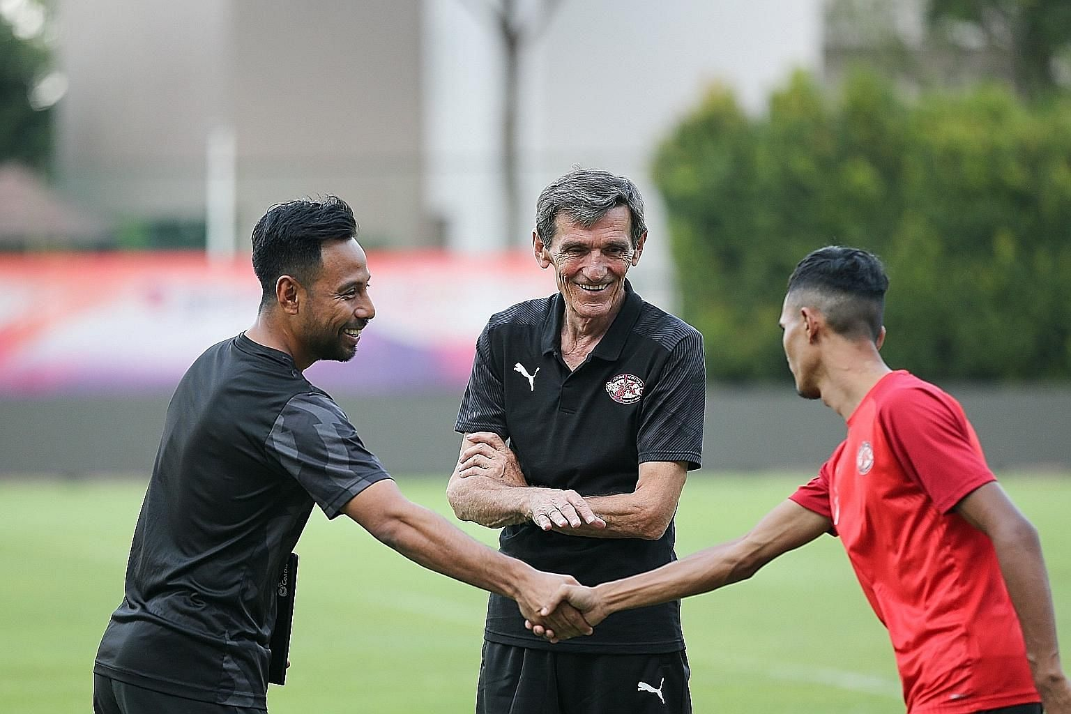New Home United coach Raddy Avramovic getting to know his men better - with assistant coach Noh Rahman (far left) and player Aqhari Abdullah during training yesterday. ST PHOTO: ONG WEE JIN