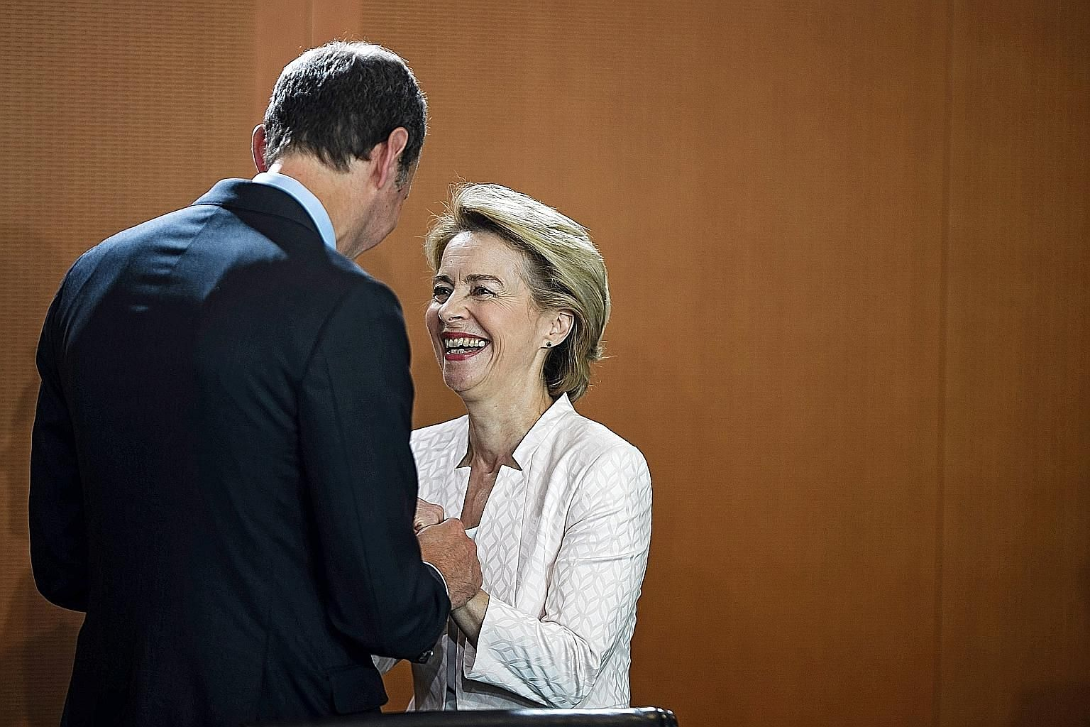 German Defence Minister Ursula von der Leyen and Minister of State for Bureaucracy Reduction and Federal-State Relations Hendrik Hoppenstedt before a Cabinet meeting at the Chancellery in Berlin yesterday. Dr von der Leyen had been named a candidate