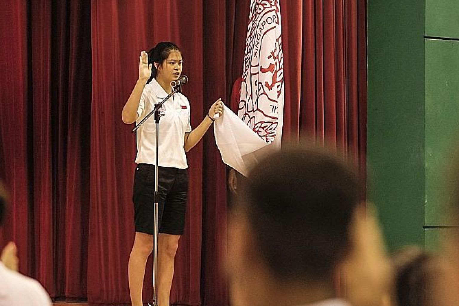 Tennis player Joelle Goh leading the Singapore contingent in reciting the oath during the Asean Schools Games send-off ceremony at Tanjong Katong Secondary School yesterday.
