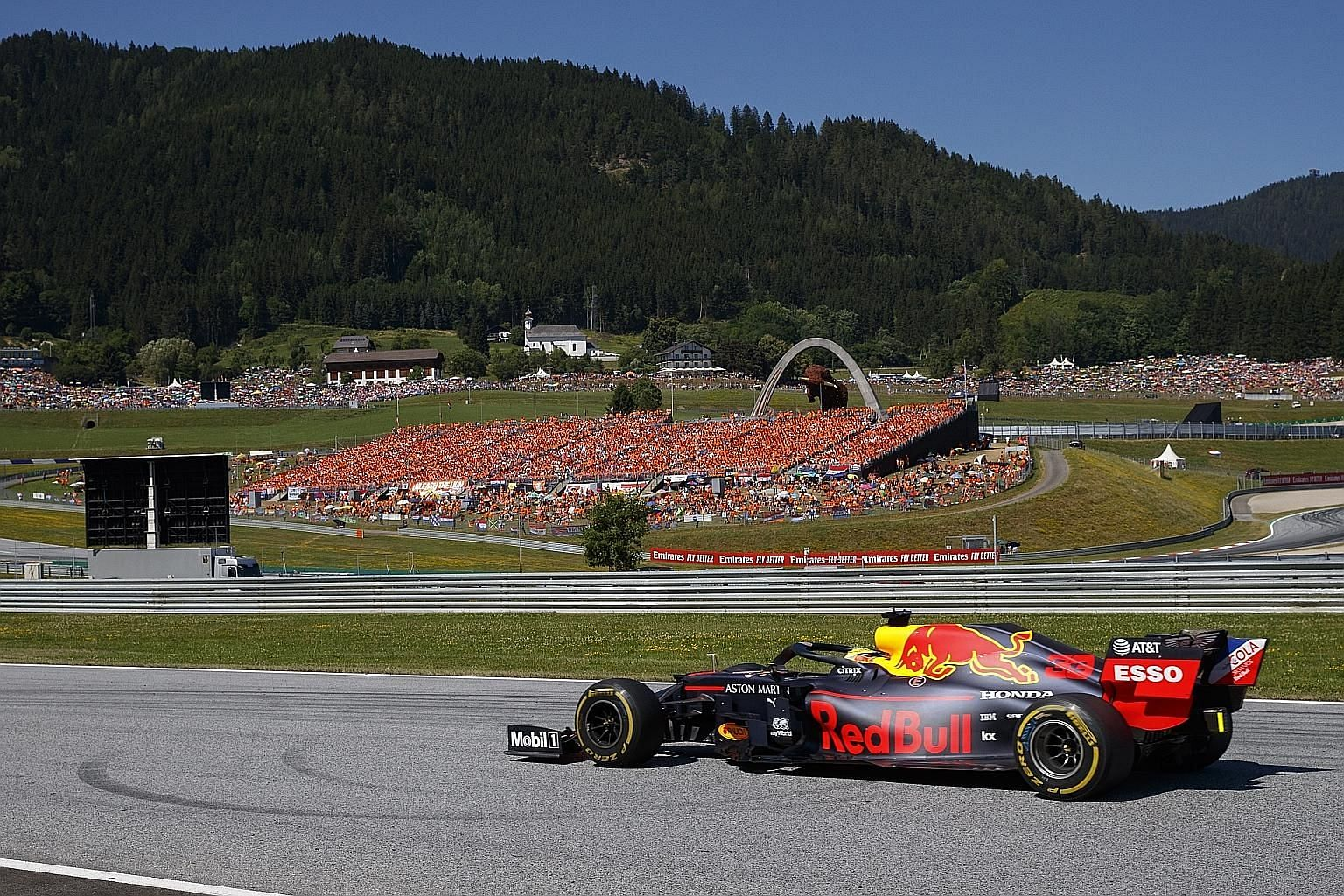 Red Bull's Max Verstappen being cheered by a sea of orange, his fellow Dutchmen, to victory in last Sunday's Austrian GP in Spielberg. Still only 21, it was his sixth victory from 90 race starts. PHOTO: EPA-EFE