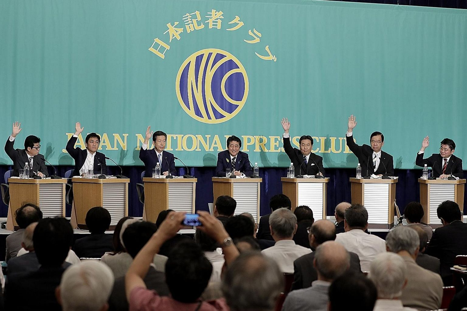 Japanese Prime Minister Shinzo Abe (centre), who is president of the Liberal Democratic Party, with other party leaders during a debate at the Japan National Press Club yesterday, ahead of Nomination Day for the Upper House election. PHOTO: BLOOMBERG