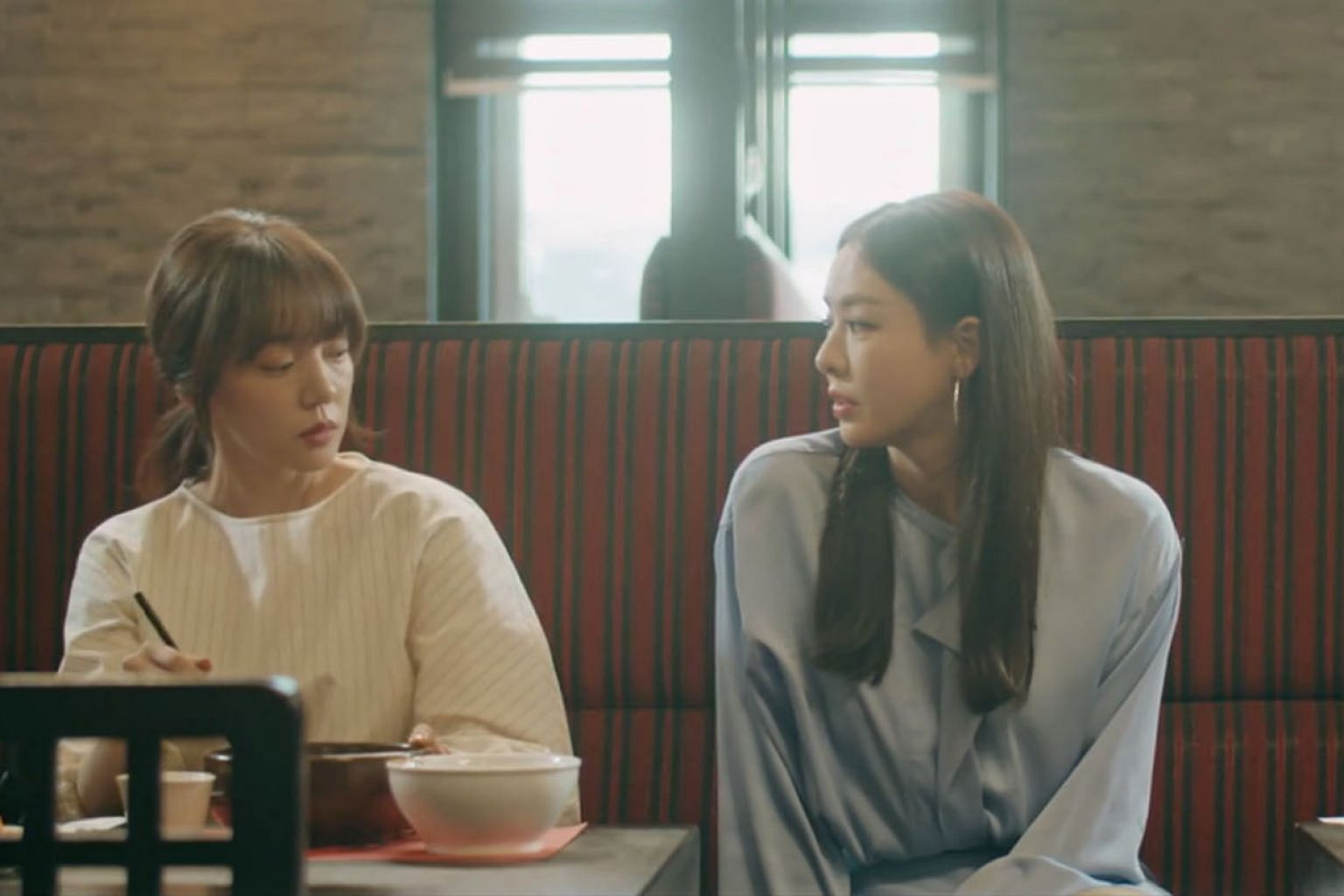 In Search: WWW, Im Soo-jung (left) plays a business rival to Lee Da-hee's character, but the two end up being colleagues.