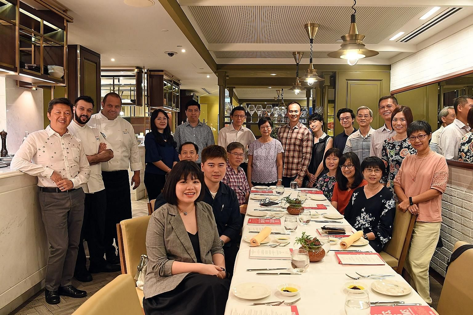 Twenty people were treated to dinner at Fratelli Trattoria in Resorts World Sentosa on Wednesday, which was hosted by ST senior food correspondent Wong Ah Yoke (far left).