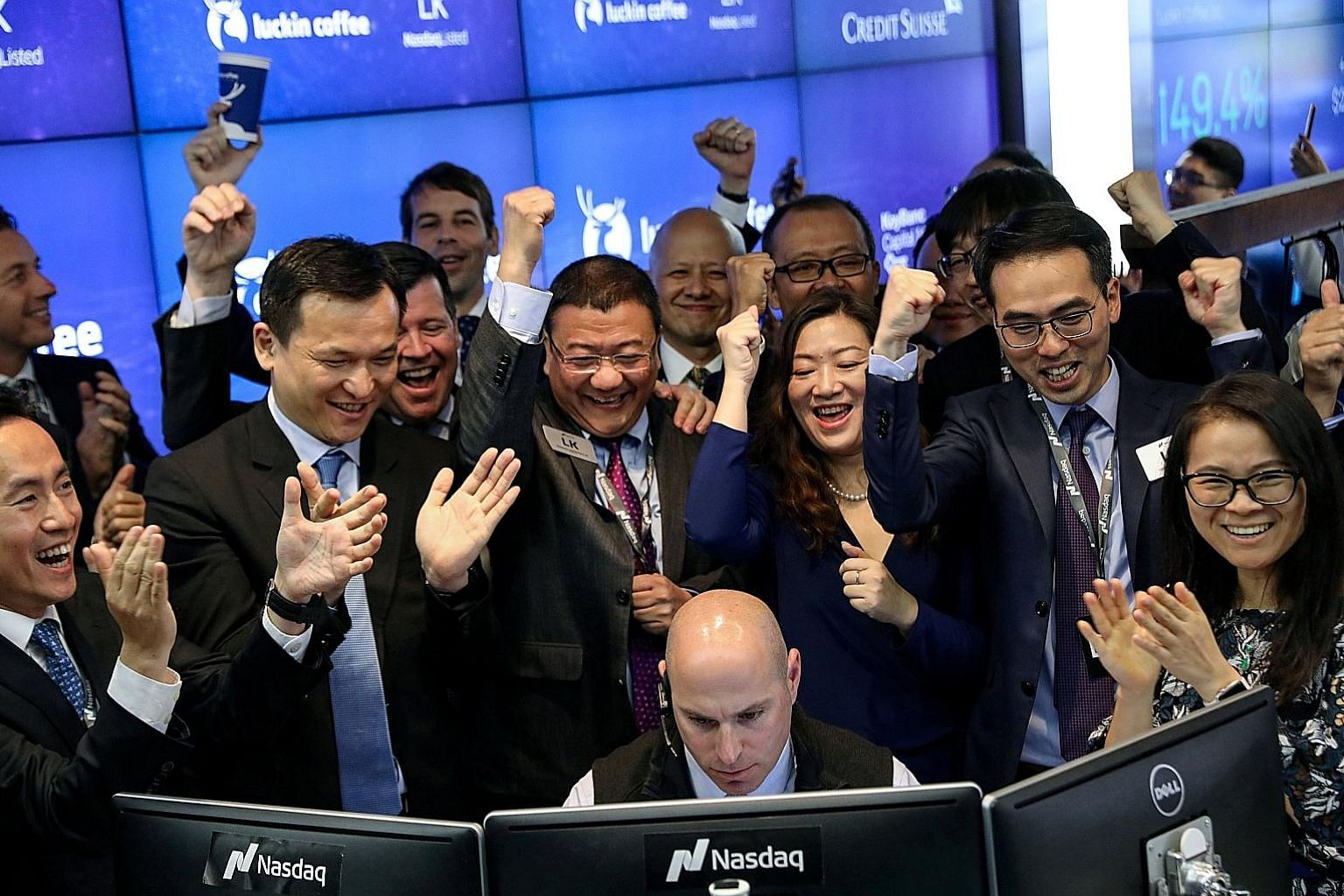 Mr David Li (second from left), CEO of Centurium Capital, celebrating the first trade of Luckin Coffee's stock with the start-up's executives during its Nasdaq debut in New York in May. Centurium was an early backer of the Chinese challenger to Starb