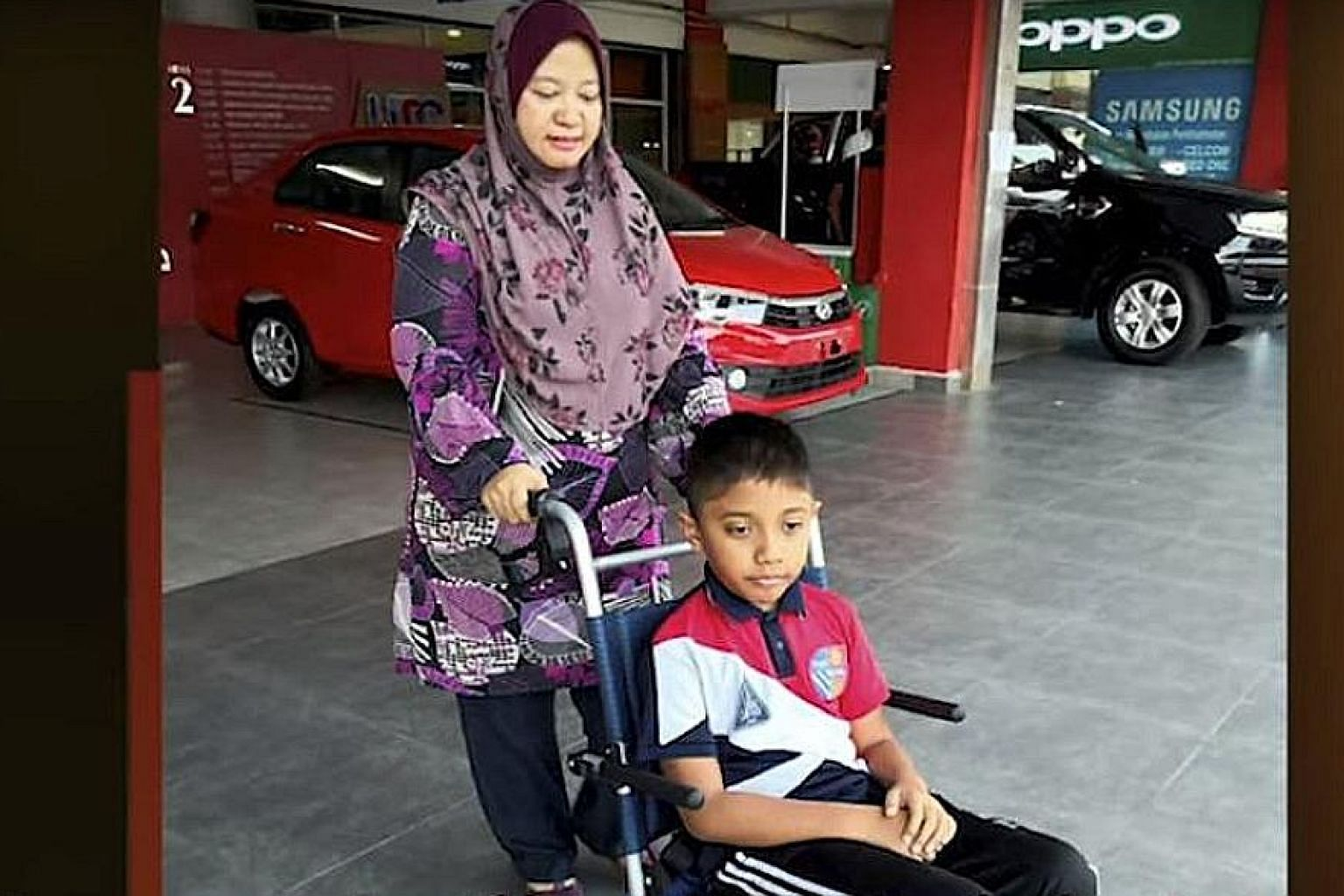 Twelve-year-old Irfan Wafiy Idham Wazir developed myokymia after sniffing poisonous gases from Sungai Kim Kim in Pasir Gudang. The Parkinson's-like condition causes parts of the body to tremble. PHOTO: METROTV