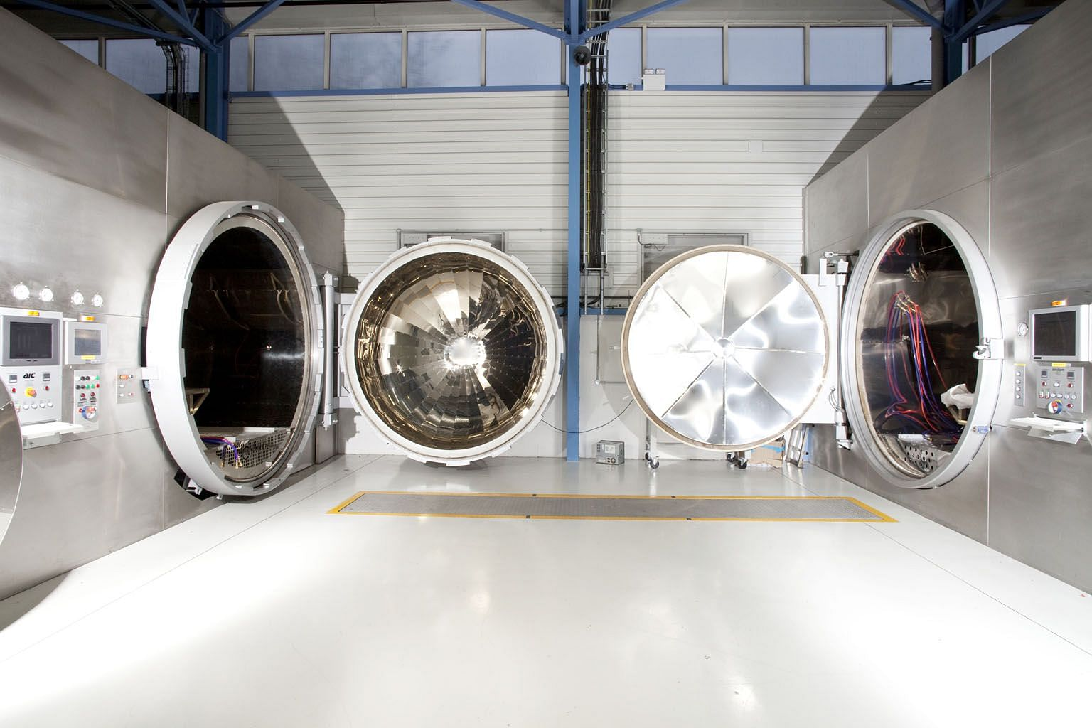 Clockwise from left: Among the state-of-the-art equipment at the Red Bull factory in Milton Keynes are the autoclaves that cure the individual carbon-fibre components which form the race car's bodywork. An engineer testing the fuel supplied by ExxonM