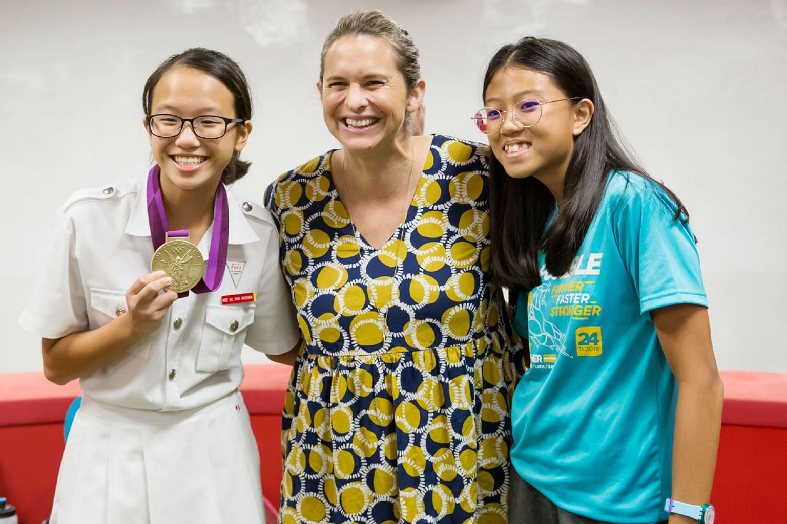 Four-time Olympic champion Libby Trickett with a pair of young athletes at the National Youth Sports Institute yesterday. The Australian was speaking to young swimmers at a sharing session. PHOTO: SINGAPORE OLYMPIC FOUNDATION