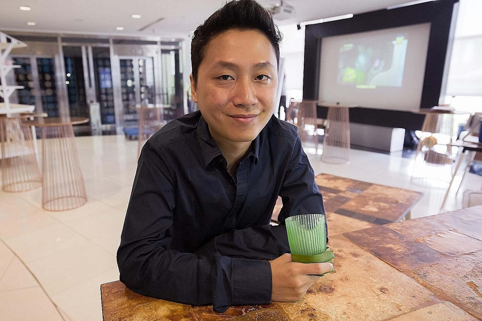 Evoware co-founder David Christian (above) with Ello Jello, a squishy, edible single-use cup made of seaweed.