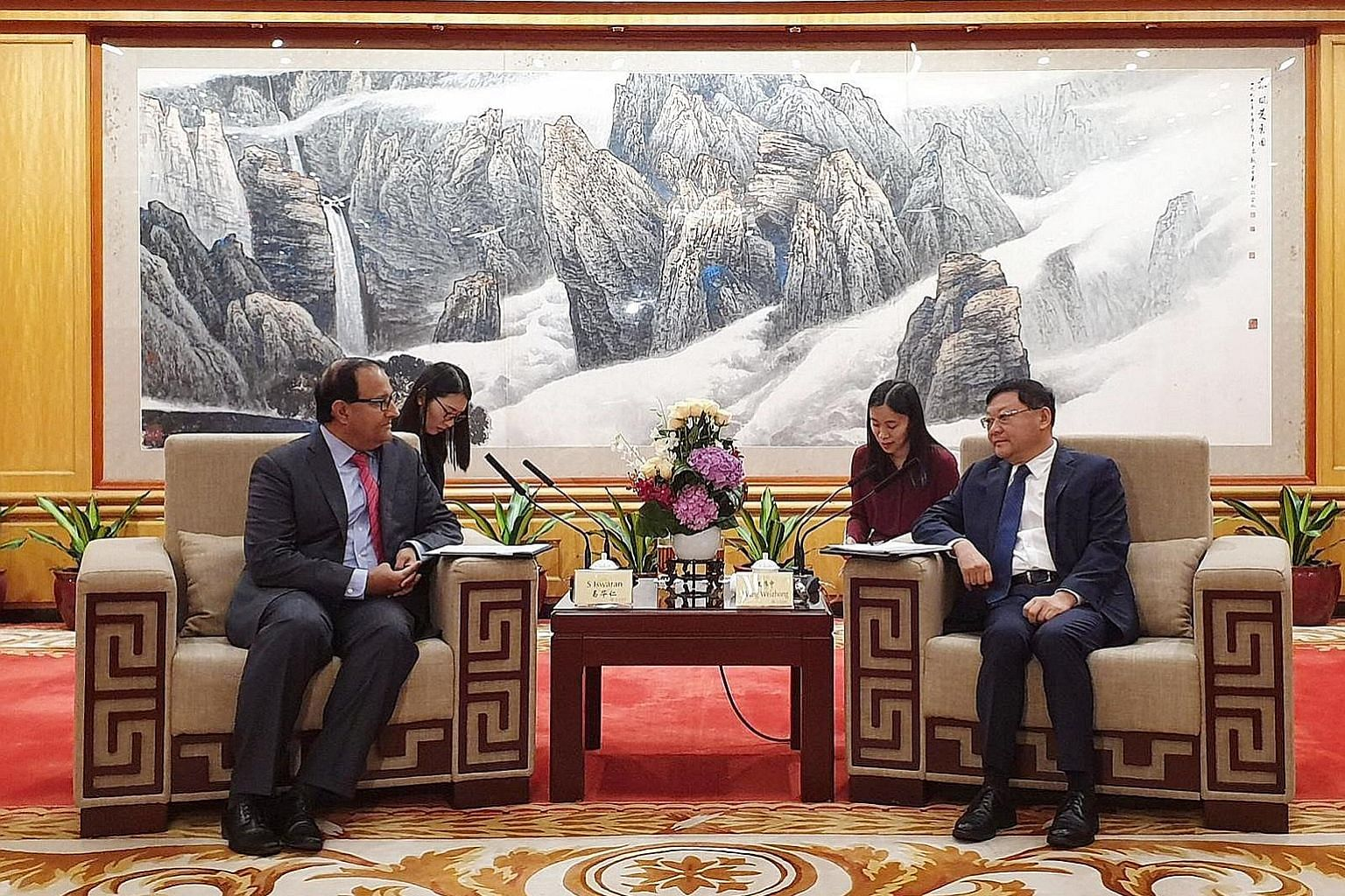 Minister for Communications and Information S. Iswaran discussing the smart city twinning initiative between Singapore and Shenzhen with the Chinese city's Communist Party secretary Wang Weizhong yesterday.