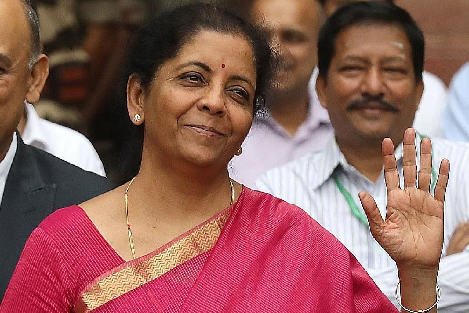 India's Finance Minister Nirmala Sitharaman departed from tradition yesterday and carried the Budget documents in a bahi khata, a traditional ledger, instead of the usual colonial-era suitcase. PHOTO: EPA-EFE