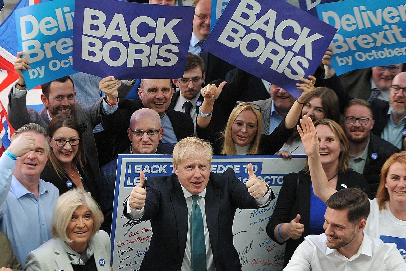 Mr Boris Johnson with supporters at a Conservative Party event in Perth, Scotland, on Friday.