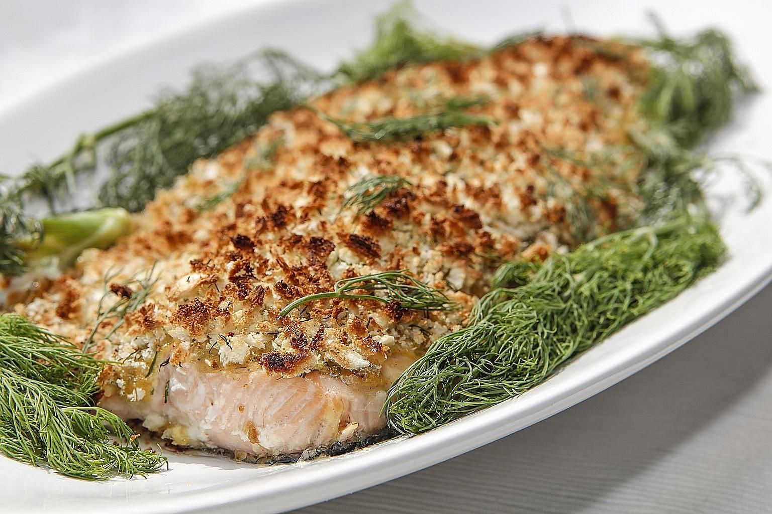Baked salmon with a dill-and-breadcrumb topping will whet appetites.