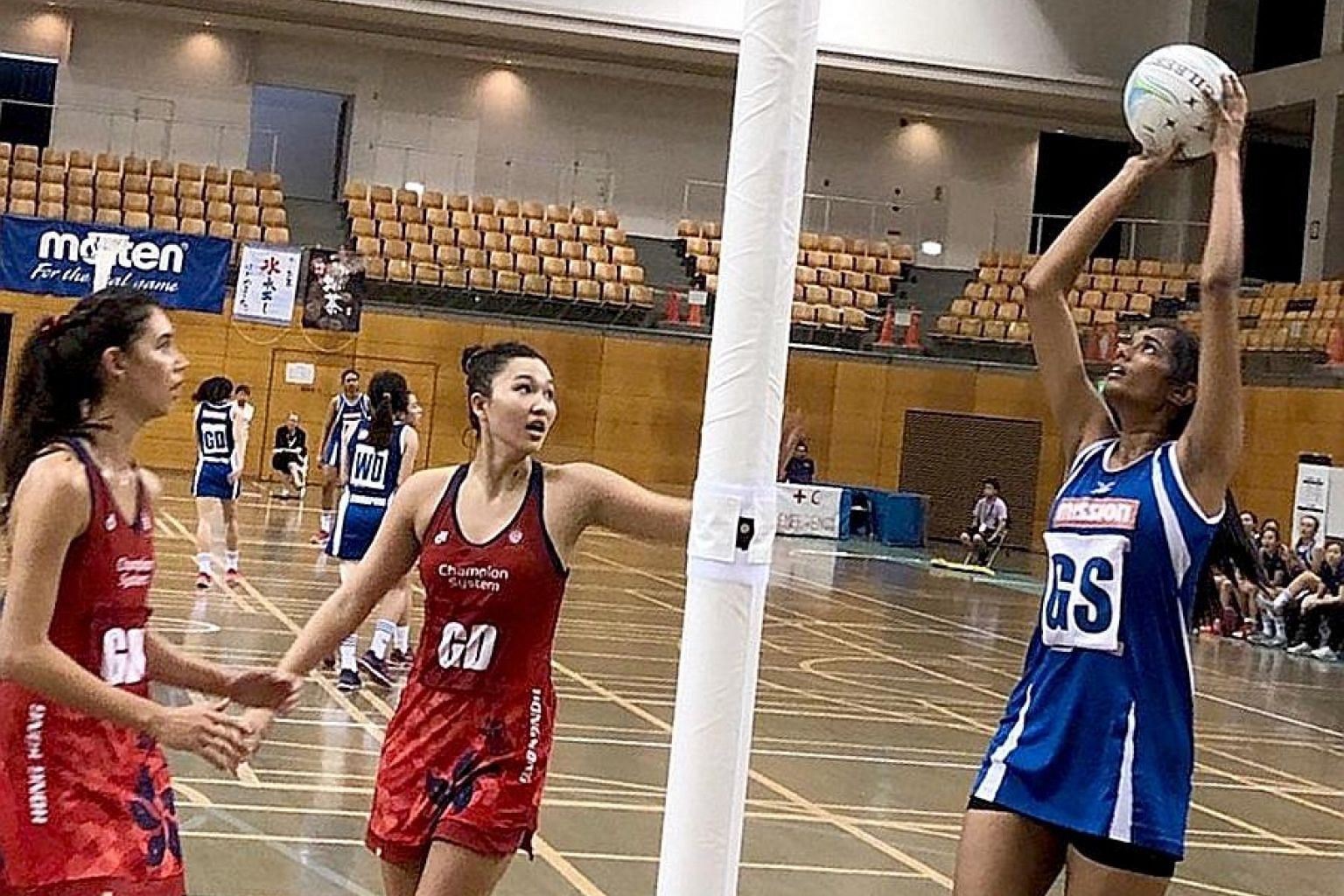 Singapore Under-21 goal shooter Pooja Senthil Kumar (right) in action during yesterday's Asian Youth Netball Championship semi-final against Hong Kong. Pooja had a 90 per cent shooting accuracy in her team's 62-36 victory.