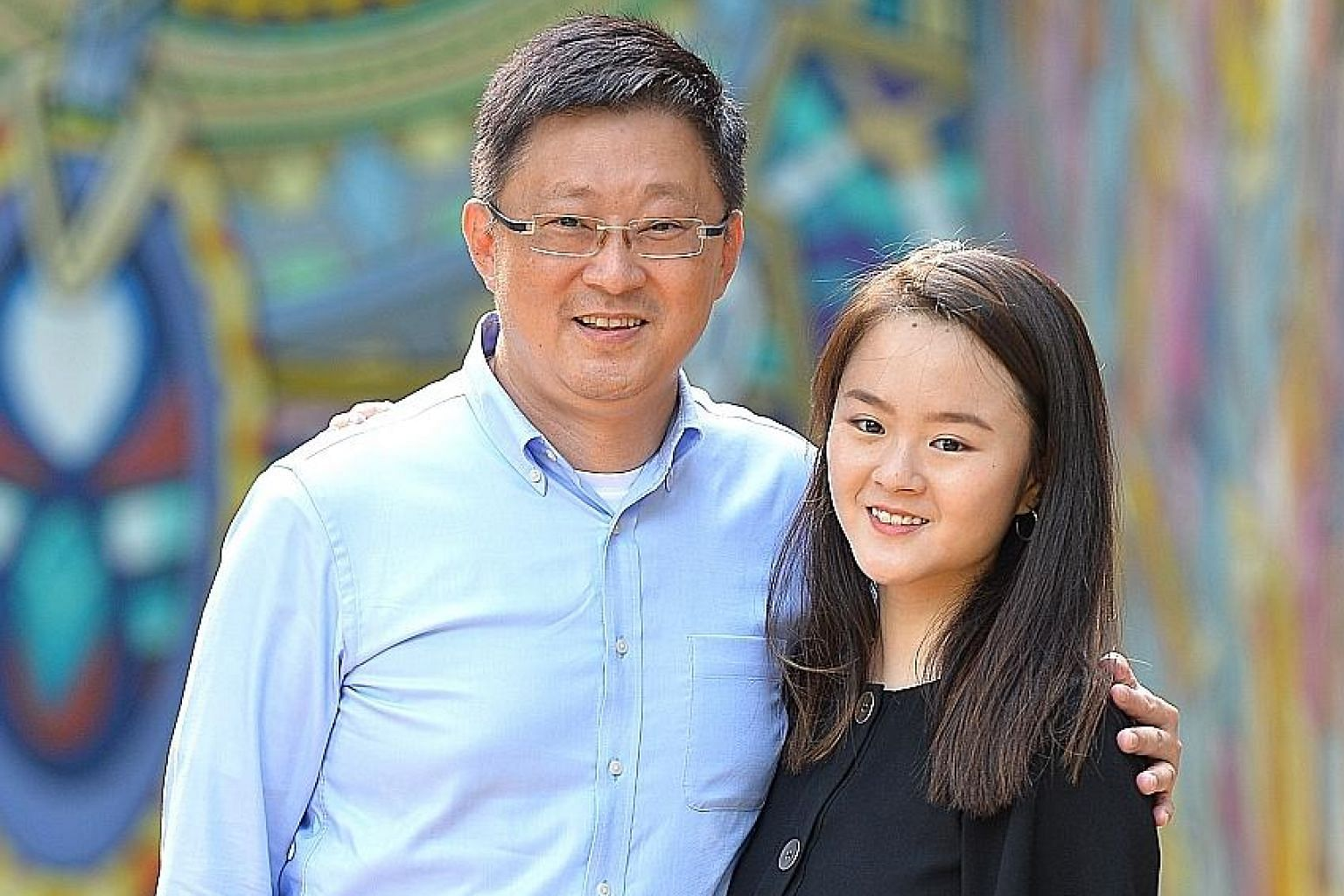 Mr Ng Kia Chiang with his daughter Kimberly, who starts work in September. Mr Ng says it is a big relief emotionally and financially that she has completed her medical degree.