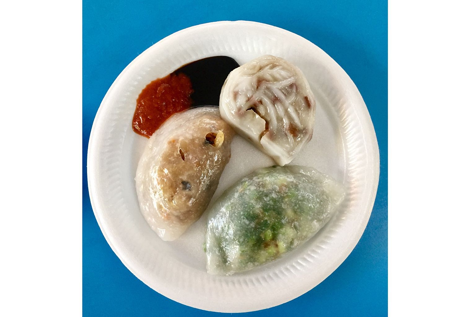 The three items are (clockwise from left) soon kueh, png kueh and koo chye kueh.