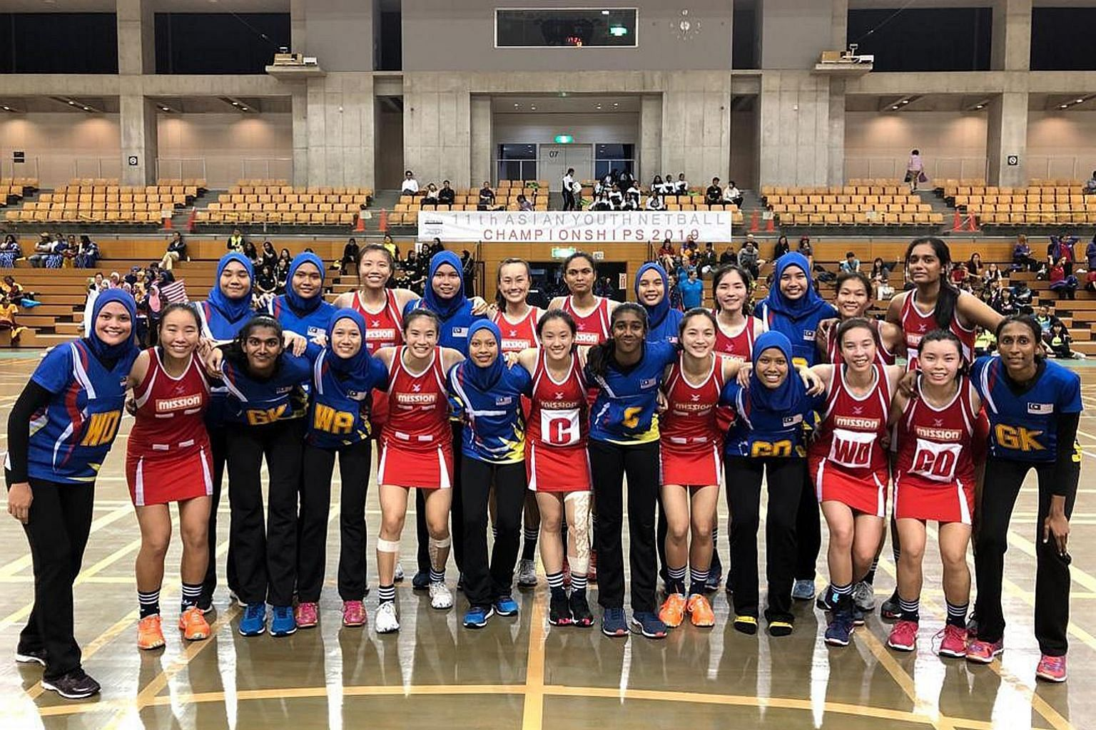 The Singapore and Malaysia Under-21 teams before the Asian Youth Netball Championship final in Kashima, Japan. Malaysia regained the title with a 57-48 win.