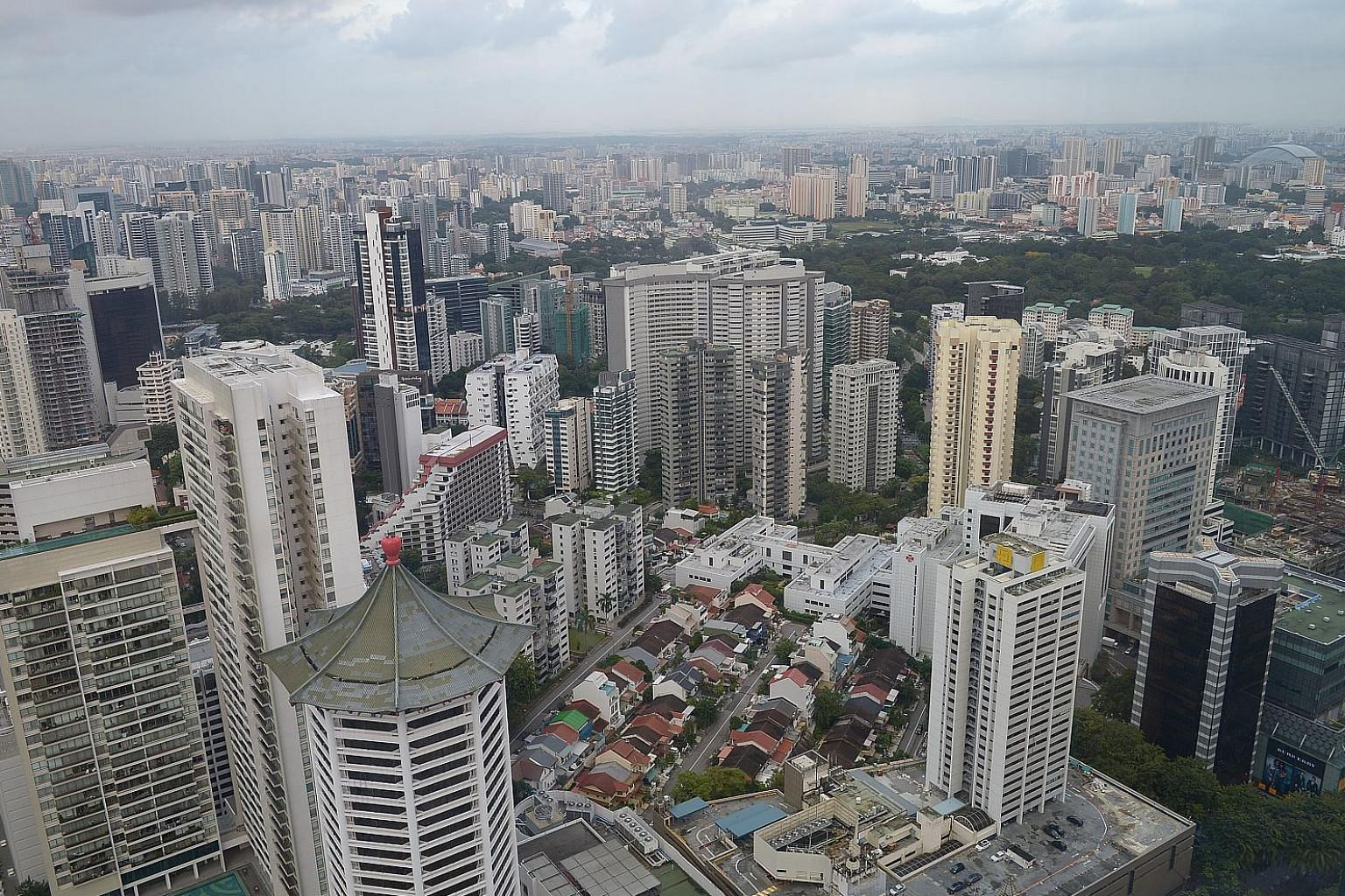 Condo resale prices in the core central region fell 0.7 per cent, while those in the outside central region retreated 0.4 per cent. Prices in the rest of central region were unchanged from May, according to estimates from SRX Property. ST FILE PHOTO