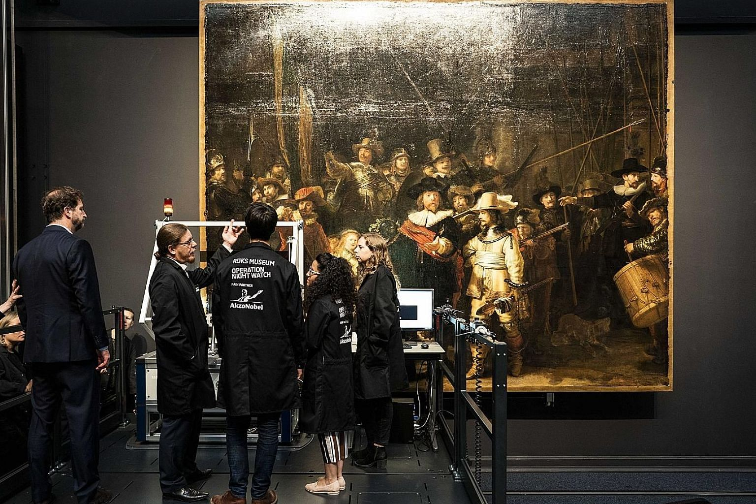Experts will work on The Night Watch inside a glass case in the Rijksmuseum, Amsterdam.