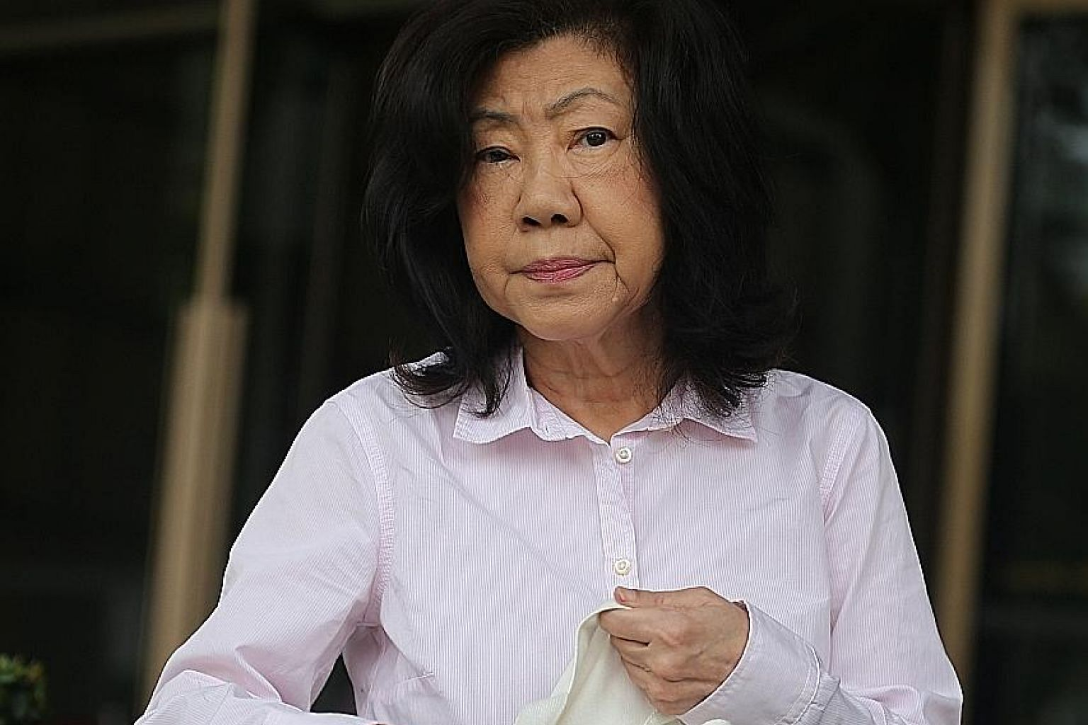 The family of Mr Ng Kong Yeam (above) alleged that Madam Kay Swee Pin (left) had filled in a pre-signed form to transfer his shareholding in SA Tours' parent company Natwest Holdings without his knowledge and consent, transferring to herself the 799,