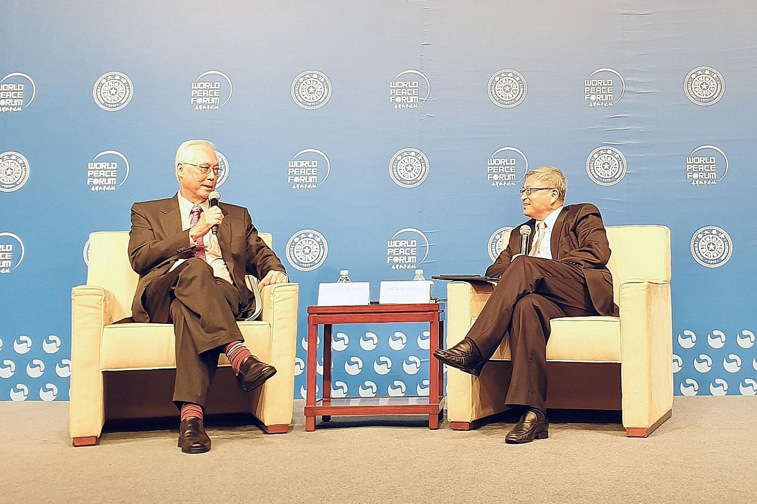 Emeritus Senior Minister Goh Chok Tong (left) with dean of Tsinghua University's Institute of International Relations Yan Xuetong. PHOTO: WORLD PEACE FORUM