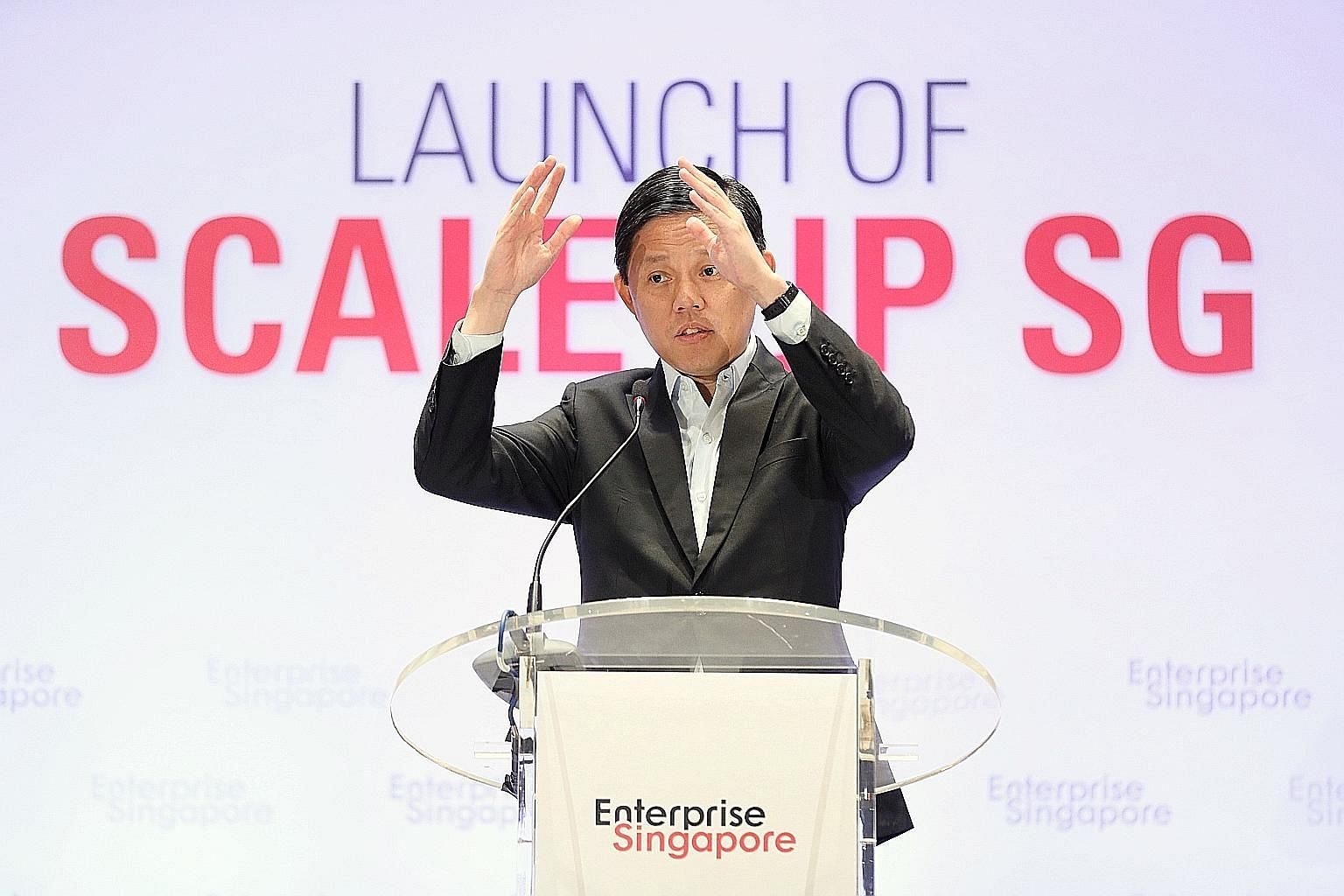 Trade and Industry Minister Chan Chun Sing speaking at the launch of the Scale-up programme yesterday. He urged firms that have been given a leg-up to create better jobs.